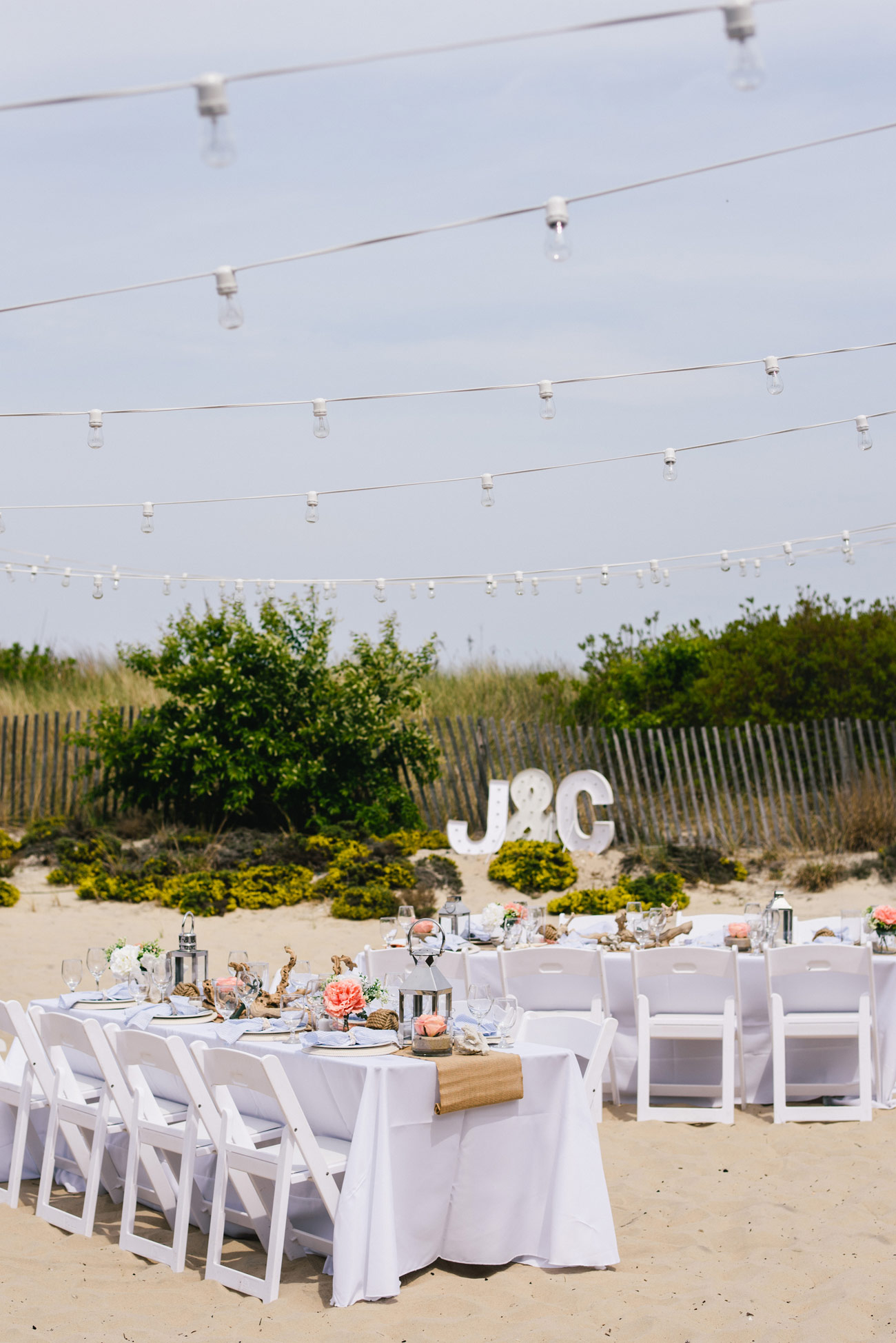 beach wedding inspiration, string lights and light monogram letters intimate beach wedding