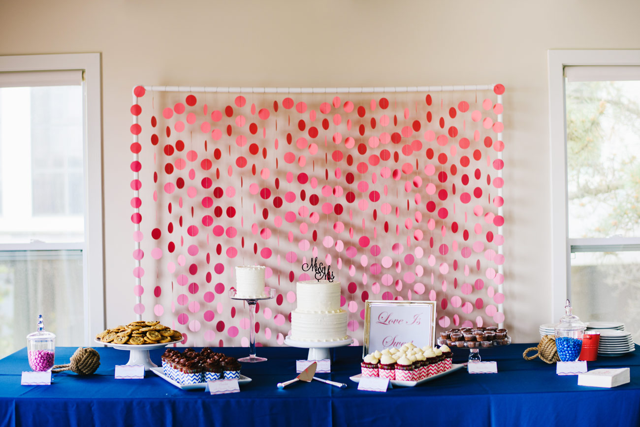 cake and sweets table with heart back drop wedding inspiration