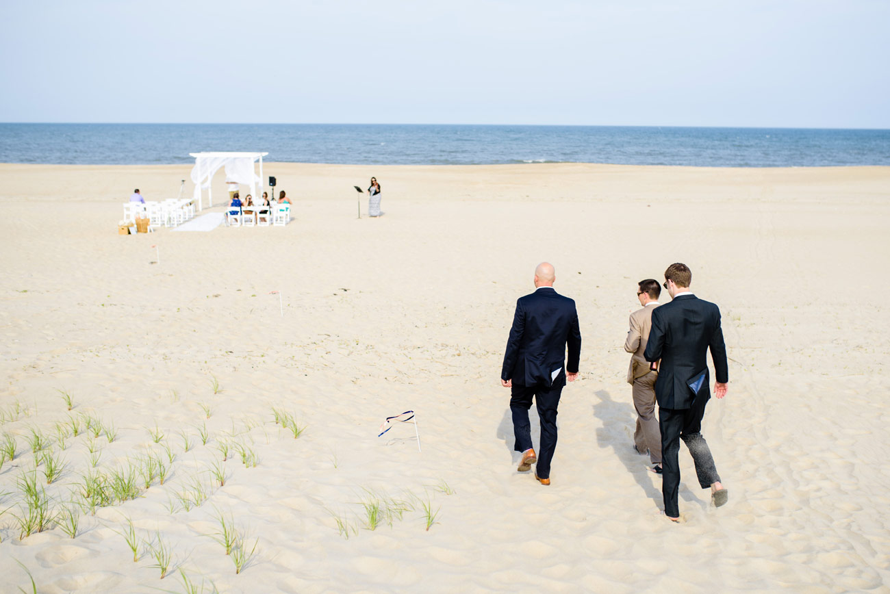 groomsmen walking to ceremony on beach bethany beach delaware new england weddings