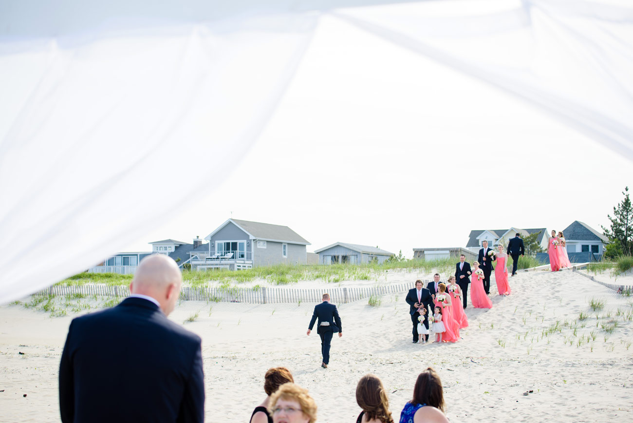 bridal party walking to the ceremony on bethany beach