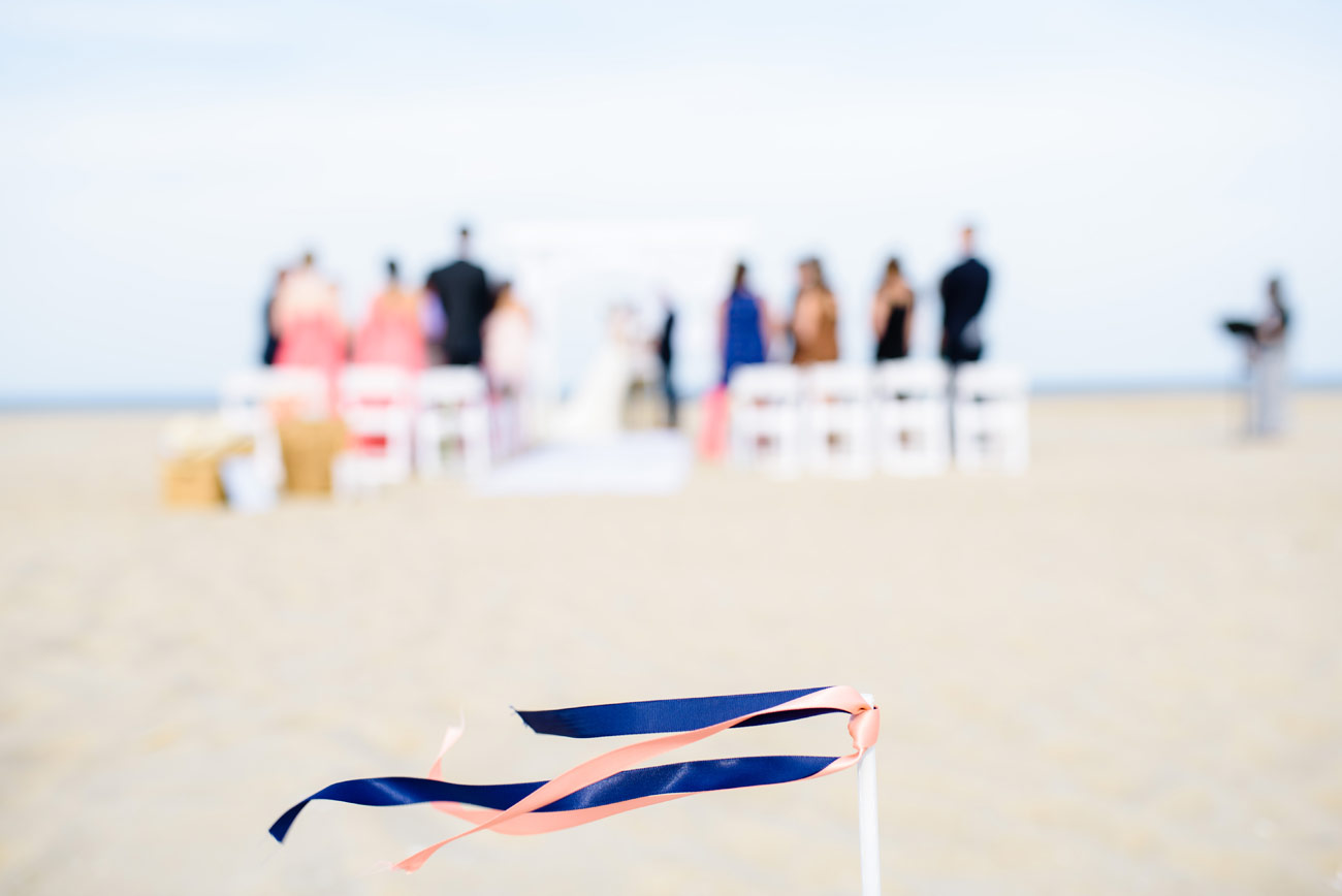 beach flags at an intimate beach wedding cape cod