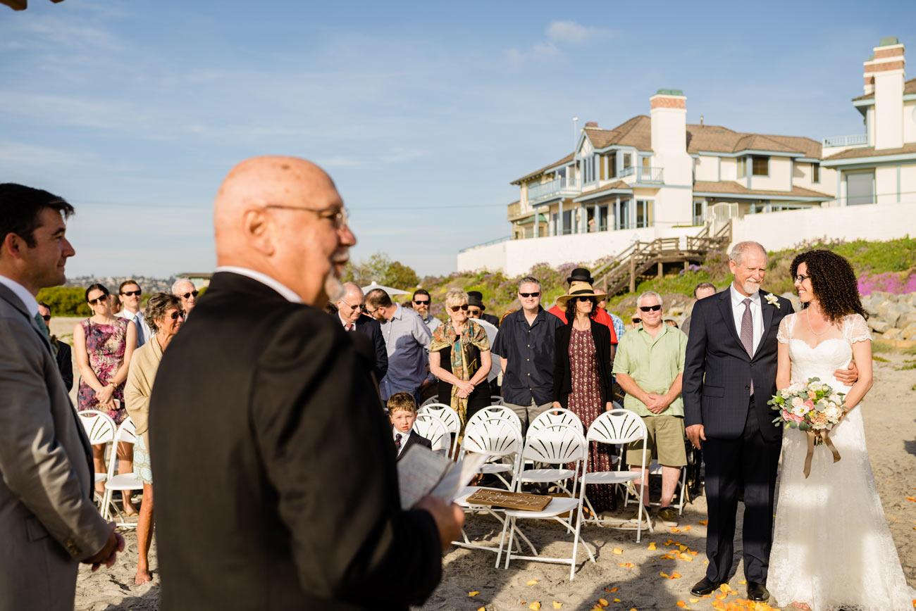 dad handing off bride on the private estate beach wedding in carlsbad, CA - beach wedding inspiration