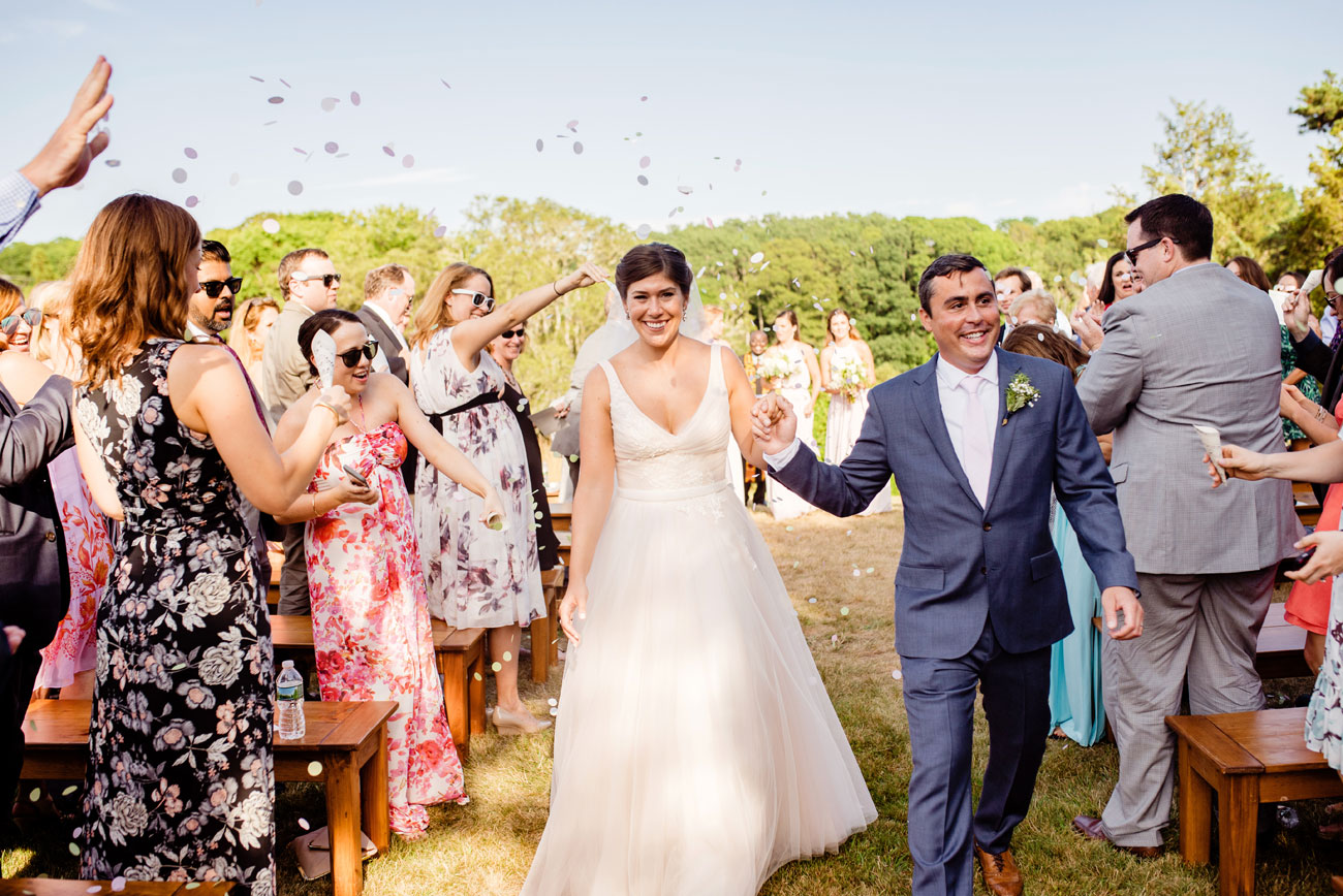 couple recessional at their outdoor cape cod ceremony at the bourne farm