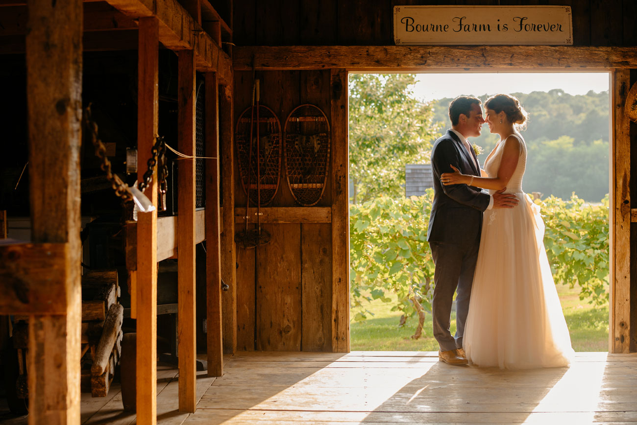 couple in the barn at bourne farm falmouth , ma wedding barn inspiration in new england