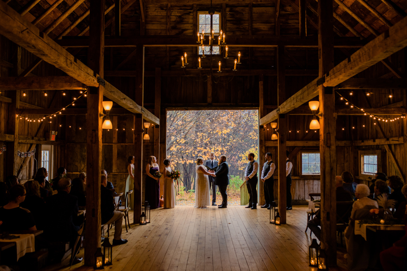 inside the barn on walnut hill wedding ceremony couple looking at each other