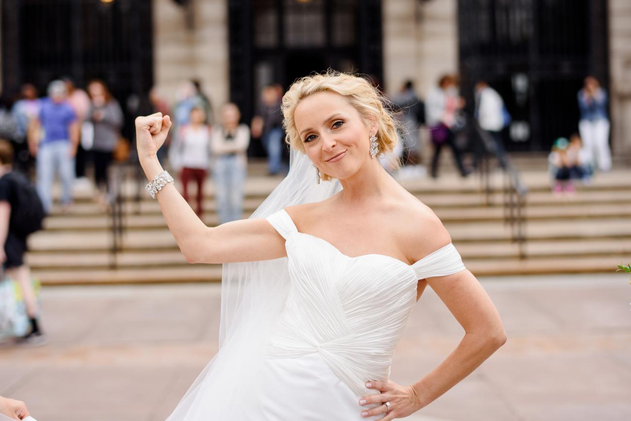 fun bride flexing in boston