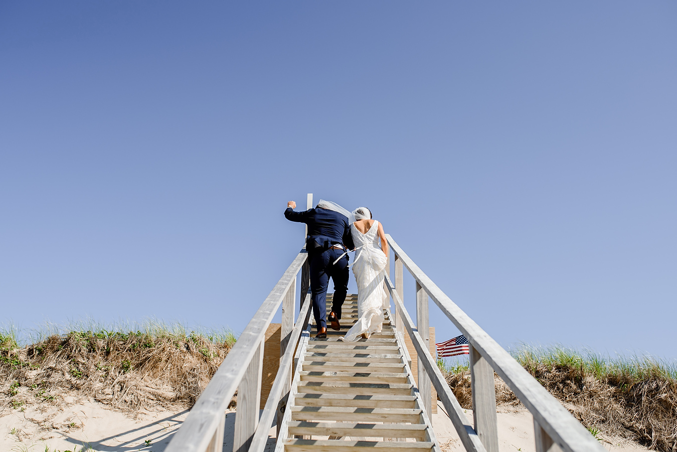 bride and groom exiting a beach ceremony on the cape