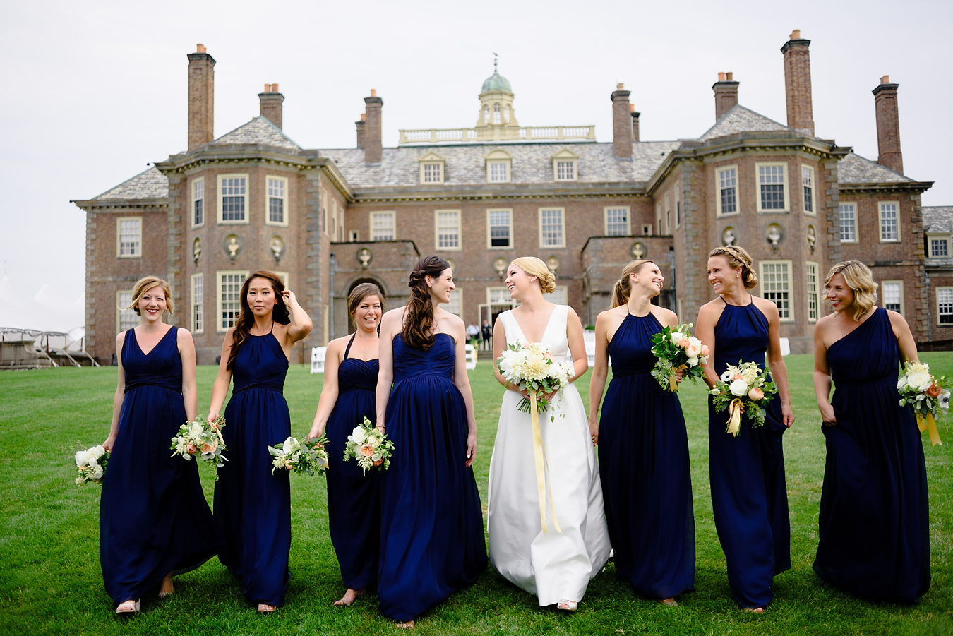 lovely bridal party walking at the crane estate
