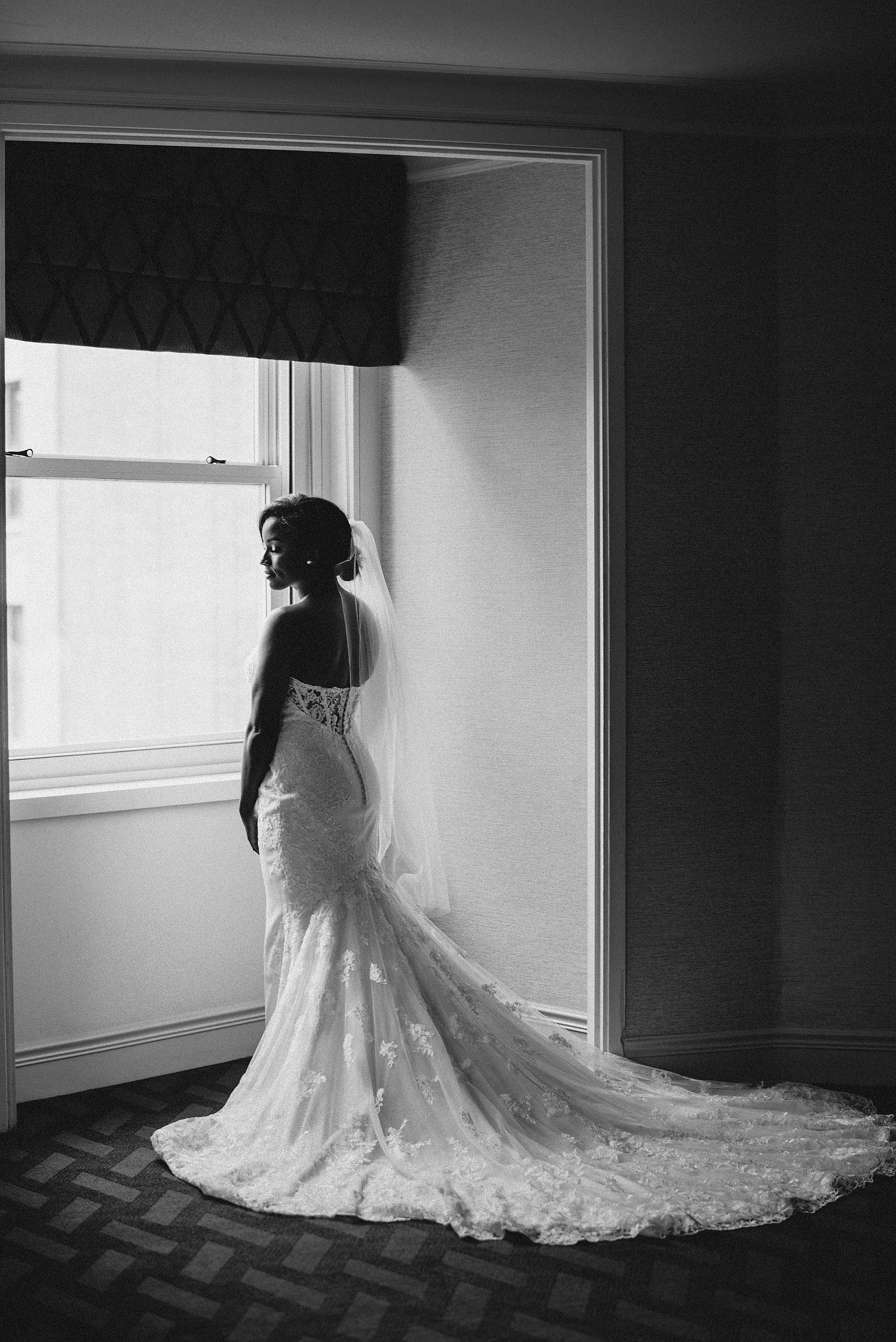 stunning african american bride at the boston park plaza hotel next to window wedding