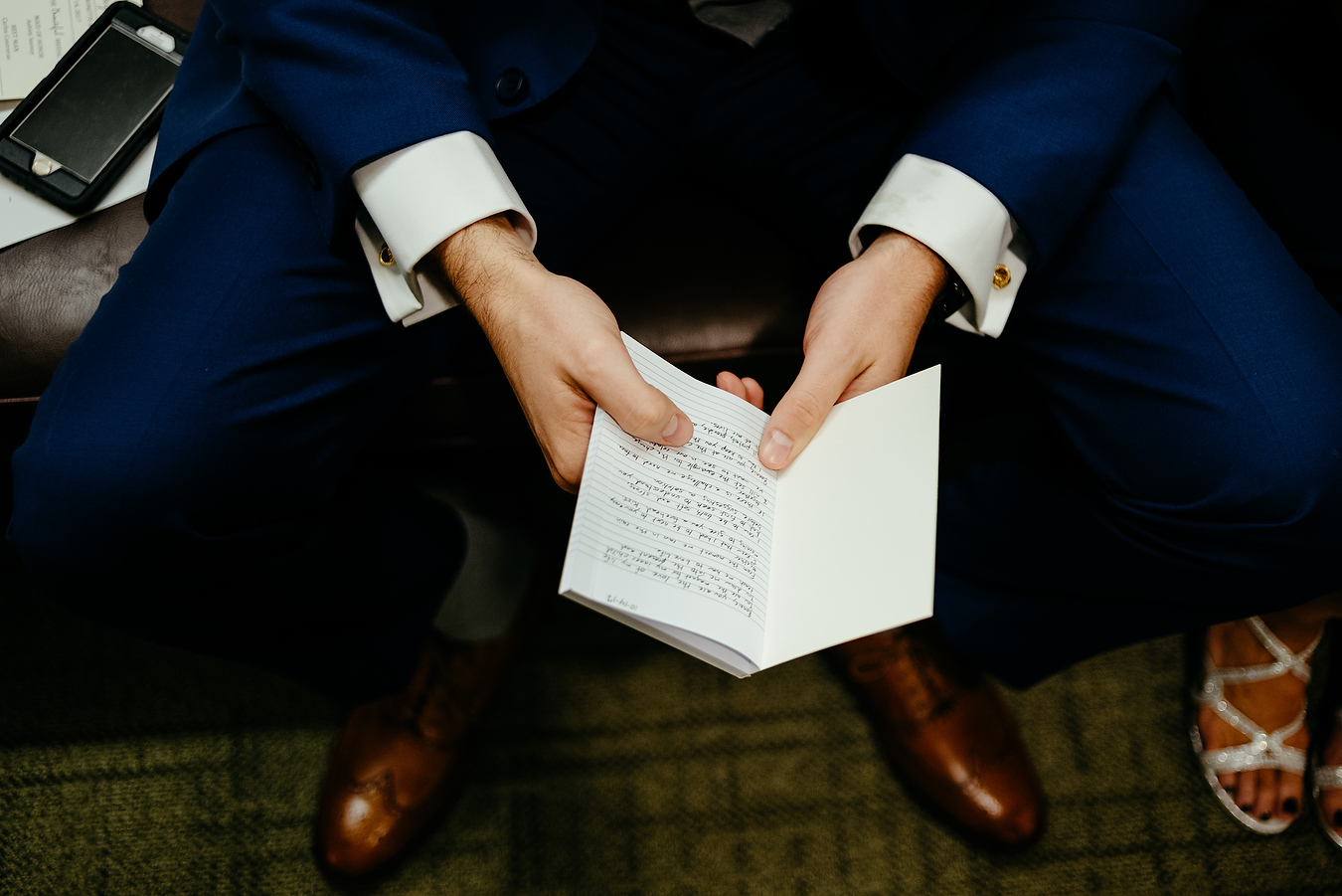groom reading his vows at the mit chapel
