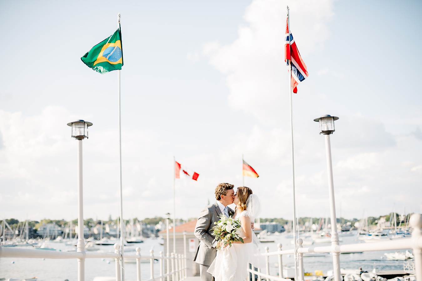 bride and groom portrait kissing on a sunny day at the eastern yacht club