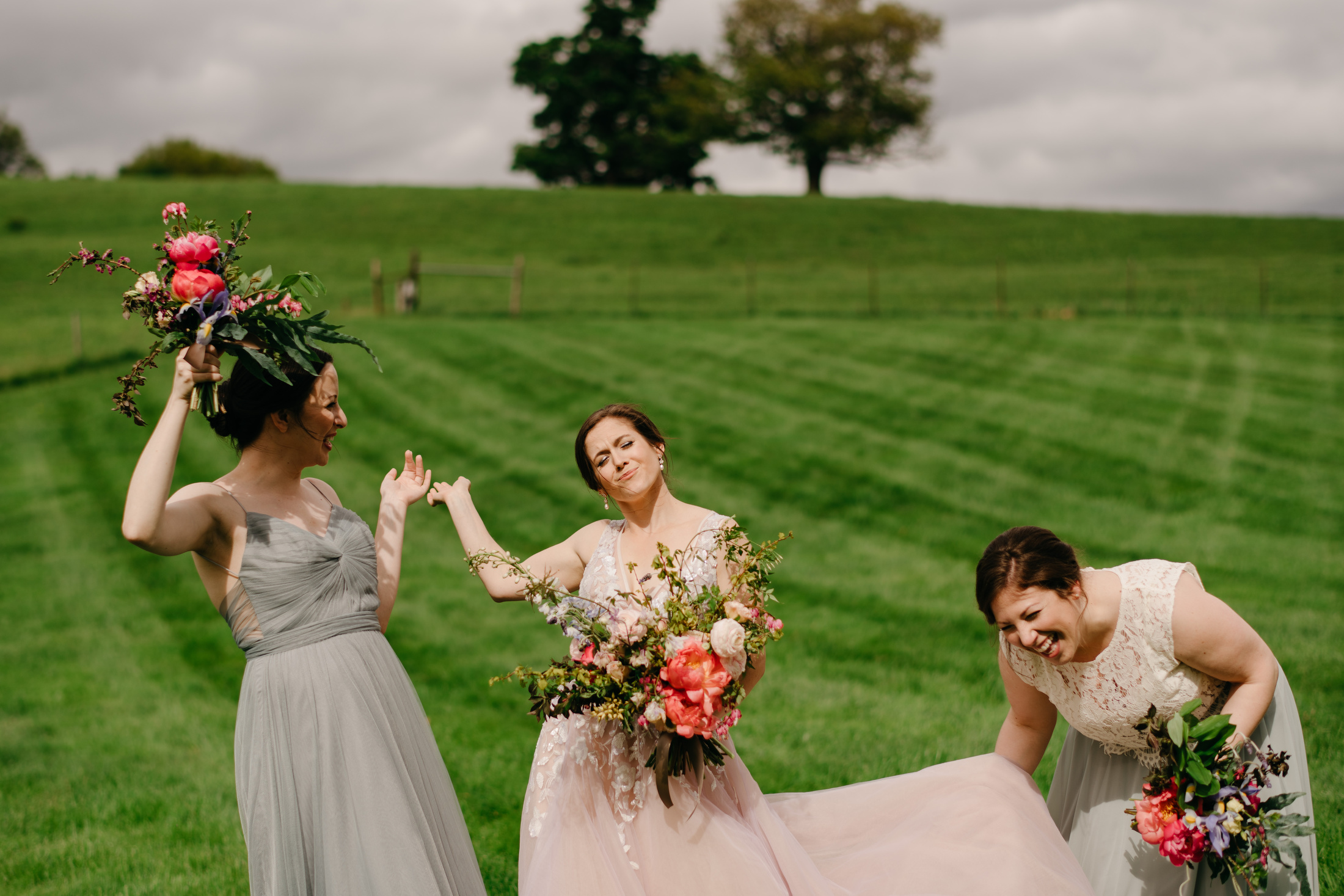 editorial style farm and outdoor wedding with bride and pink dress