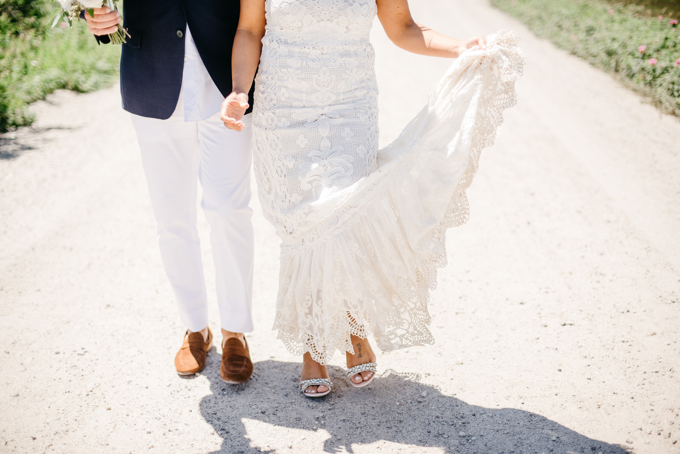 couple walking on beach in portland maine