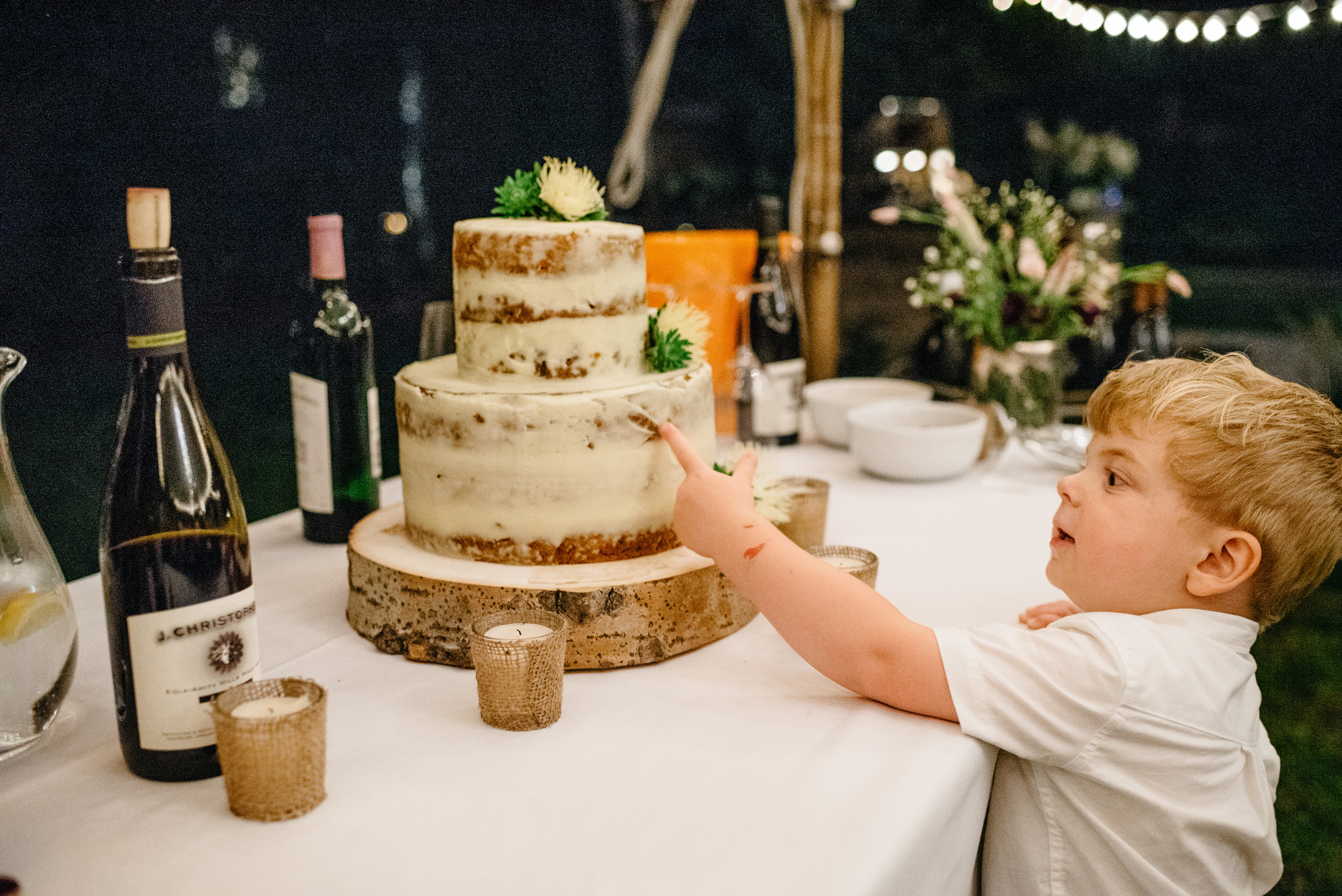 little kid eating a wedding cake