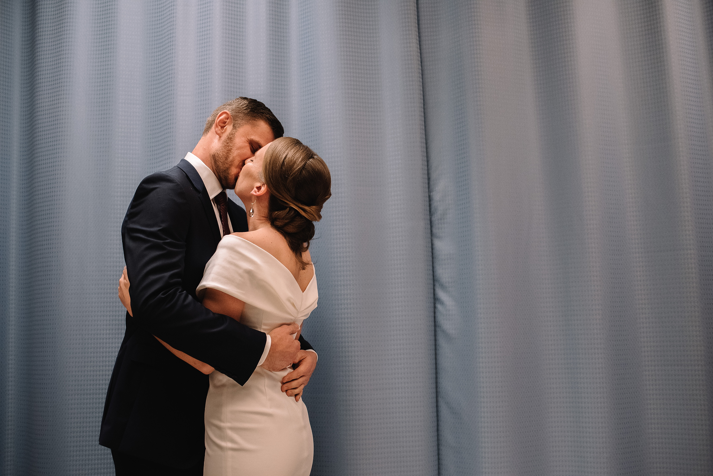 couple kissing after their intimate boston city hall elopement