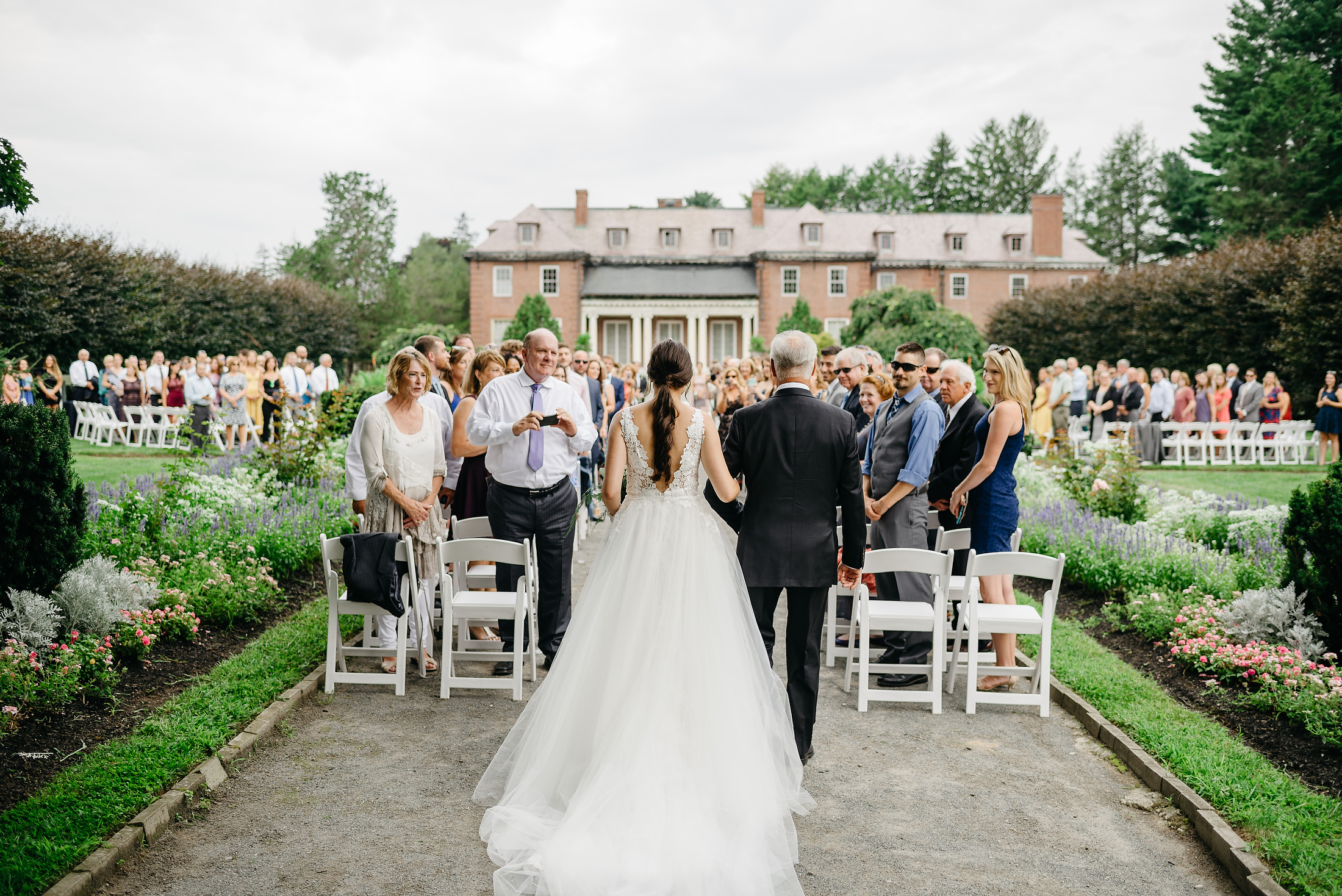 bride walking down the aisle in best outdoor venue in boston