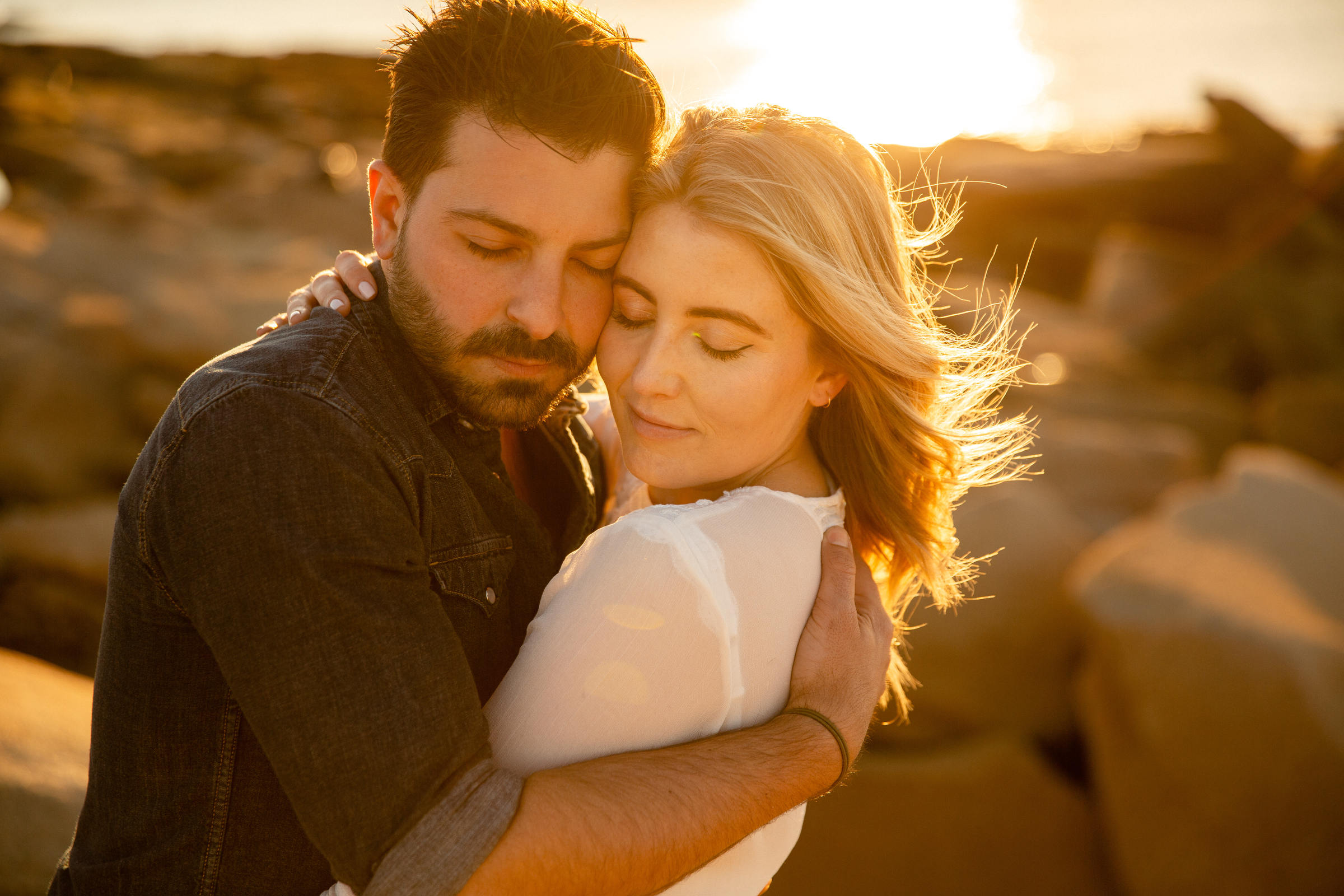 close up of couple hugging at their p-town engagement session