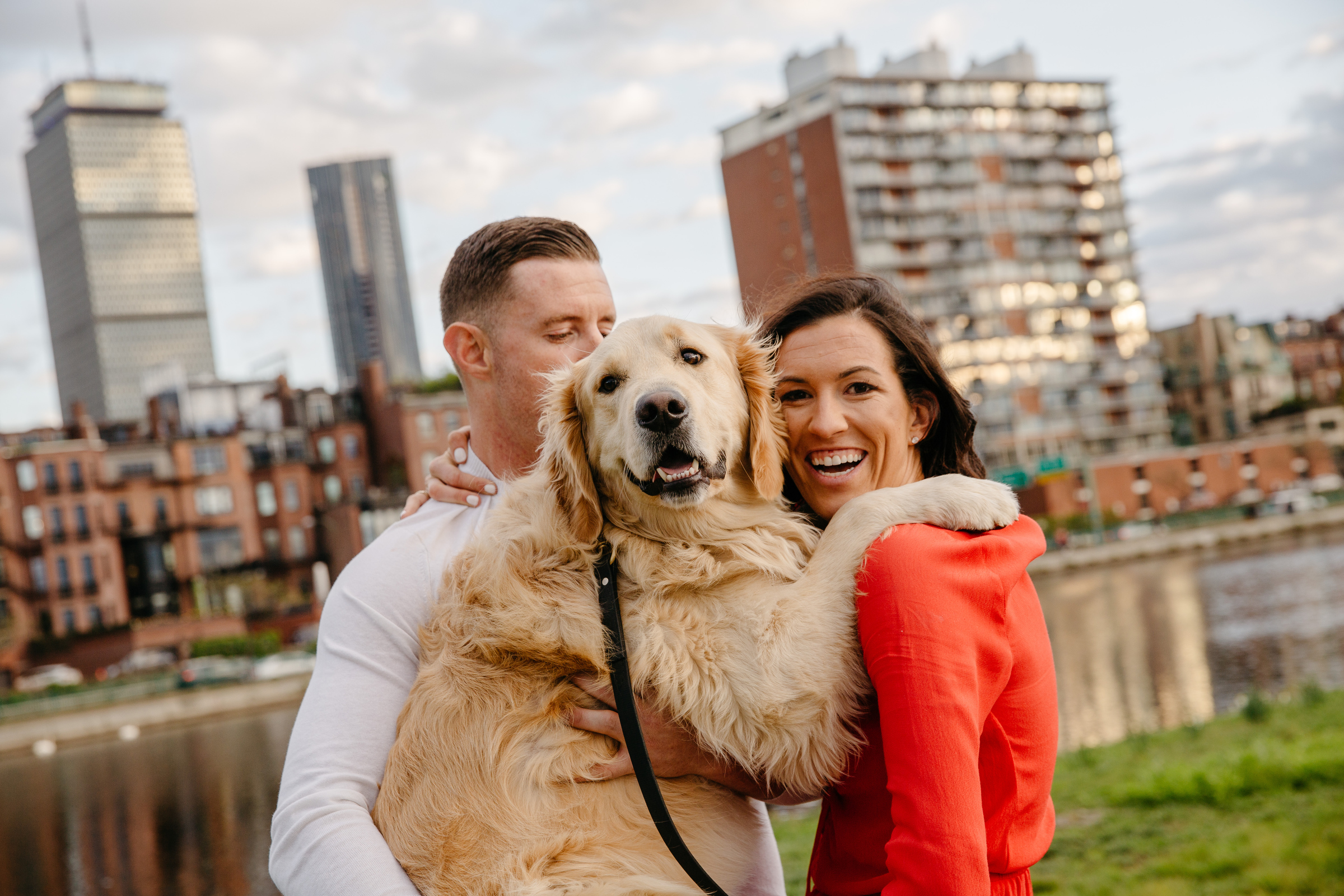 lifestyle portrait of couple in backbay boston with their golden retriver