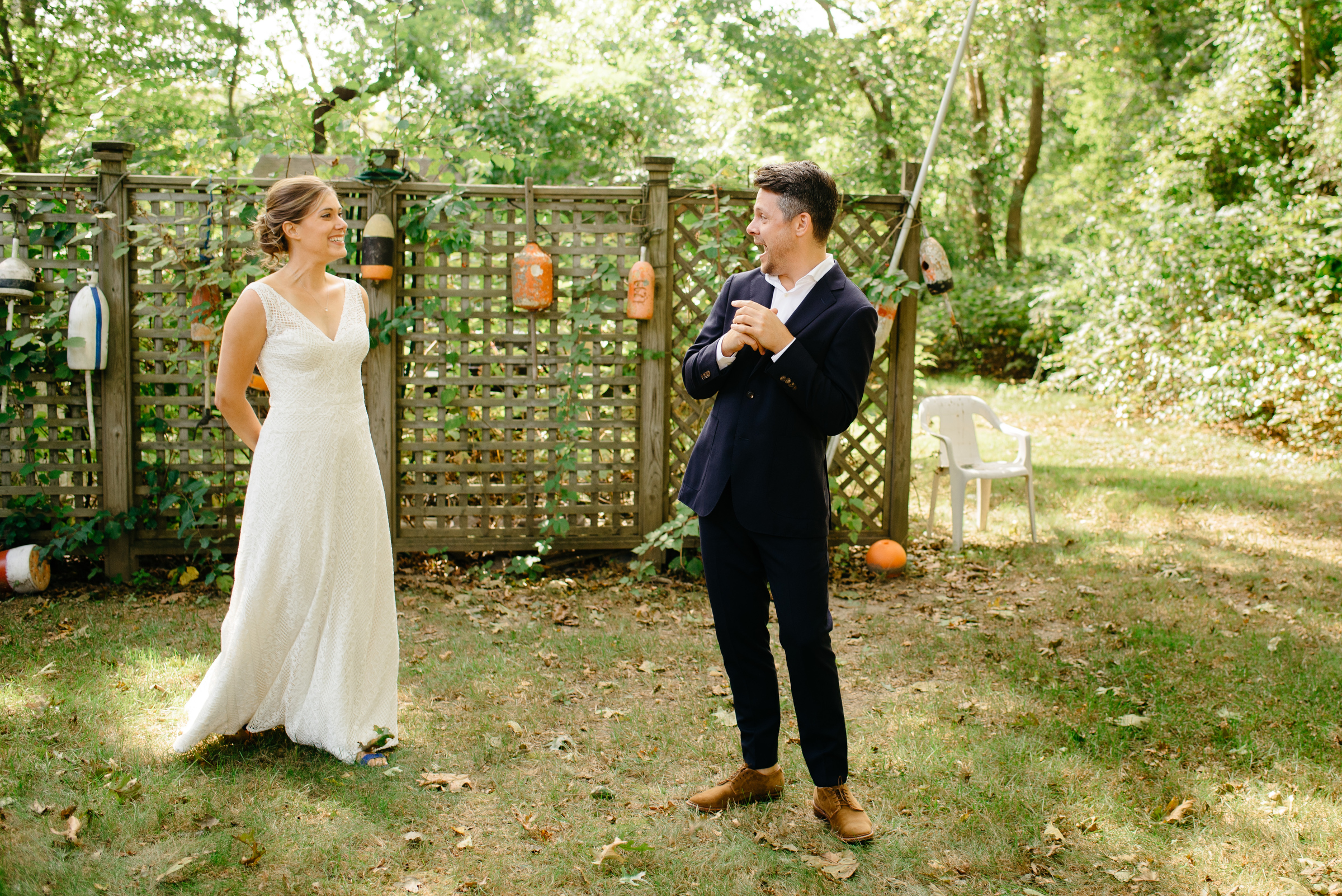 emotional first look in cape cod backyard wedding
