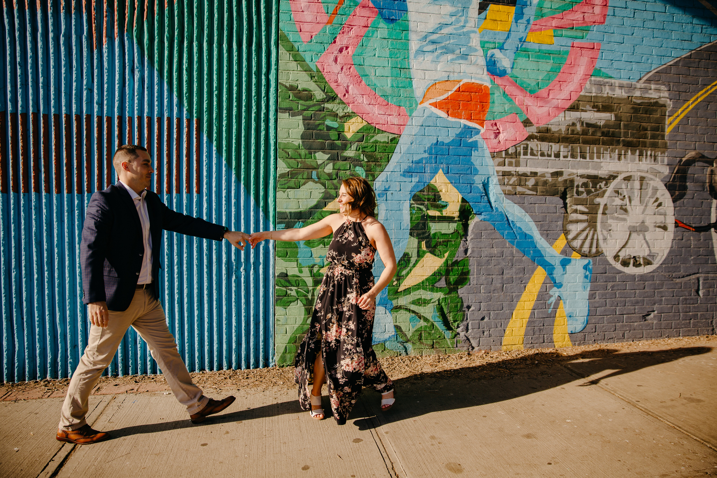 fun dumbo brooklyn engagement photos with colorful graffiti walls