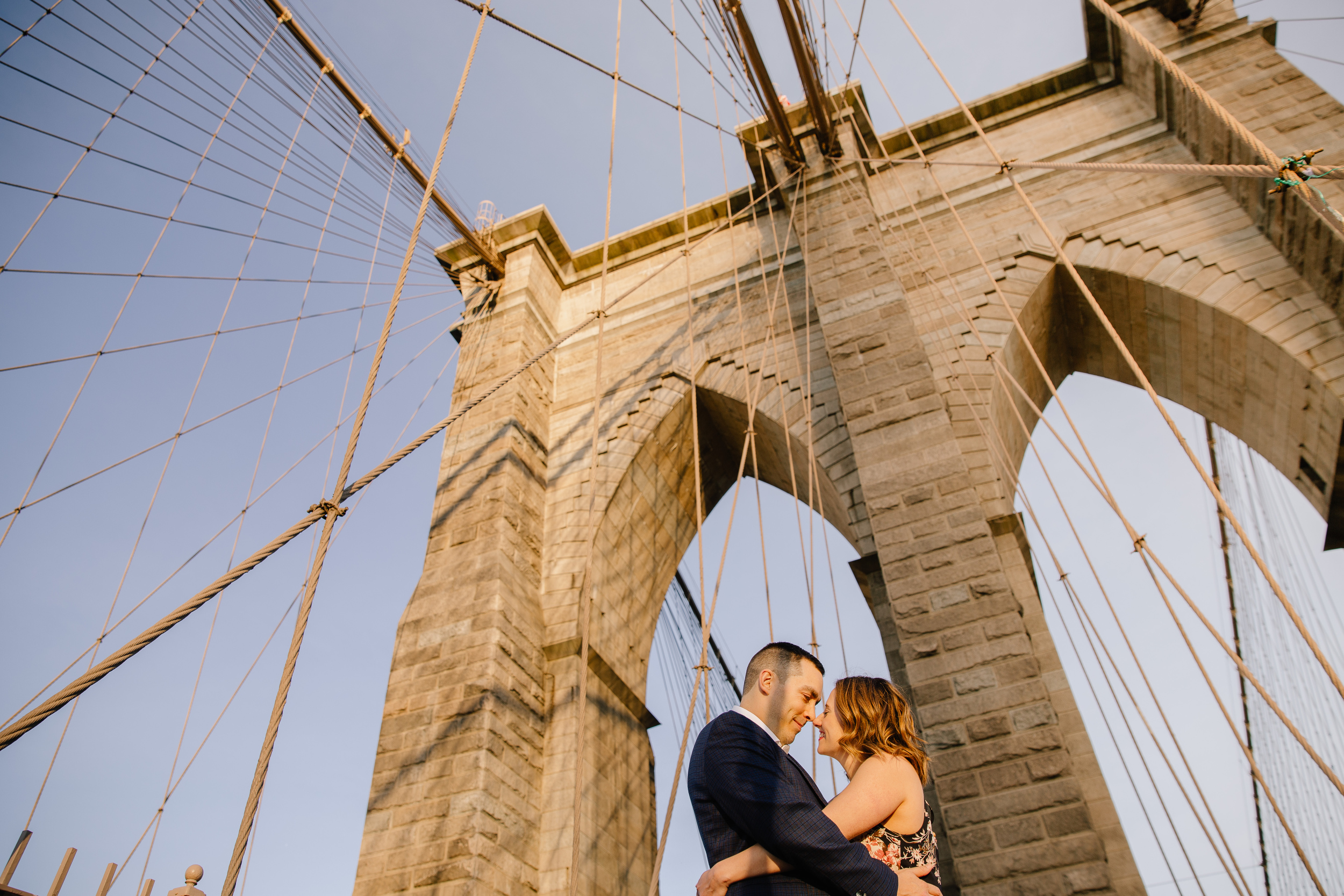 engagement session inspiration at the brooklyn bridge and views of the sky
