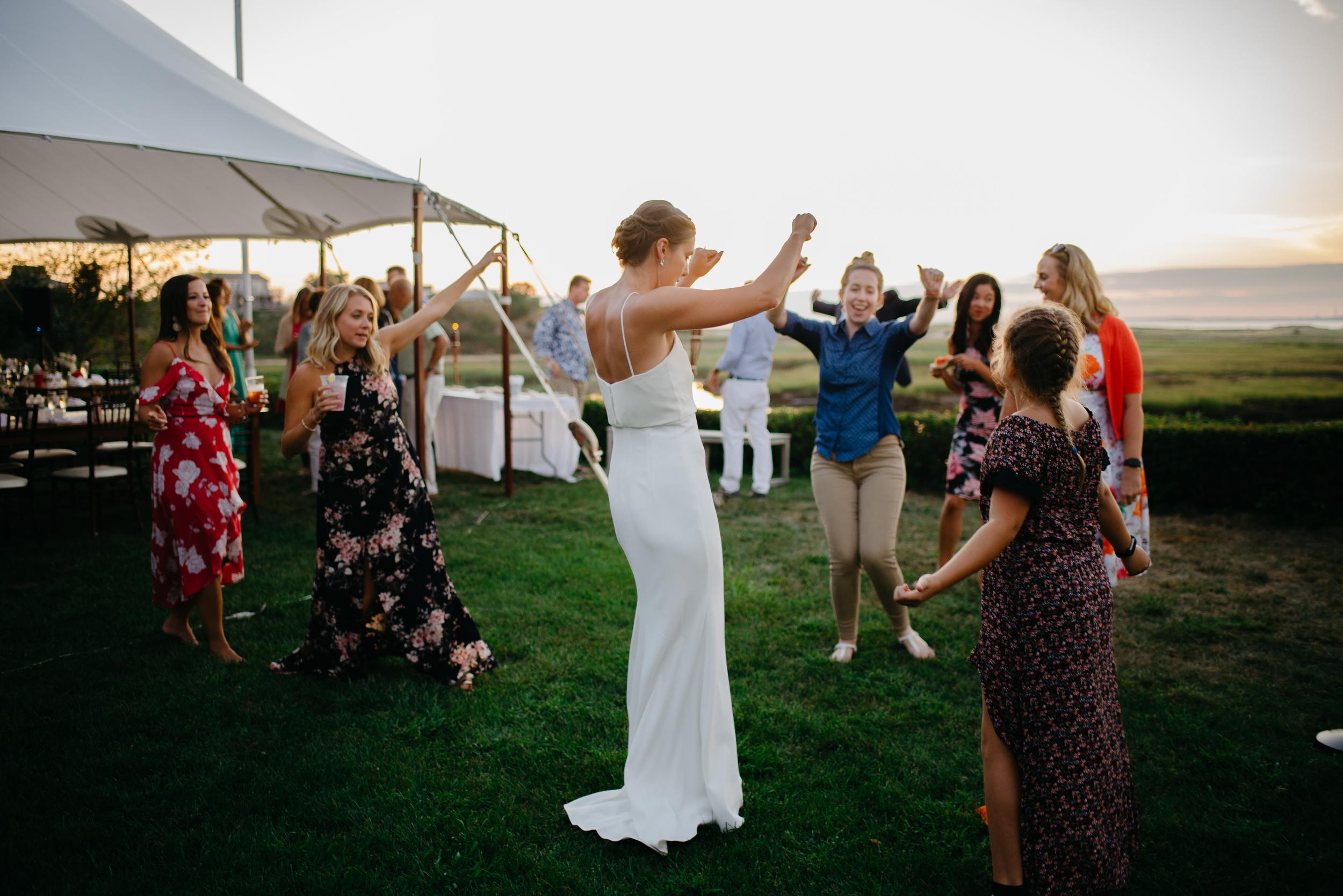 bride dancing at her tent wedding in cape cod
