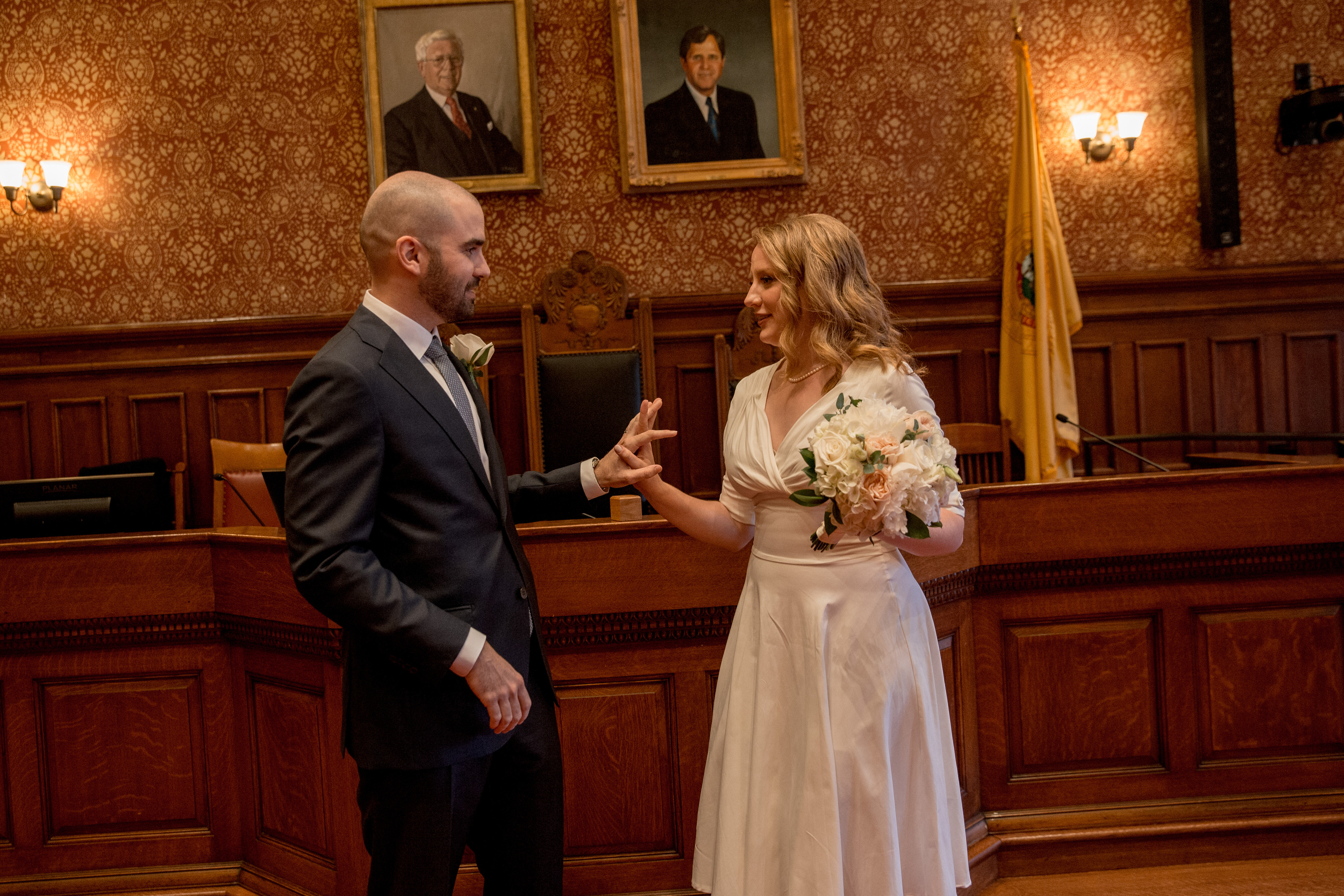 pretty couple holding hands at their cambridge city hall elopement session in massachusetts