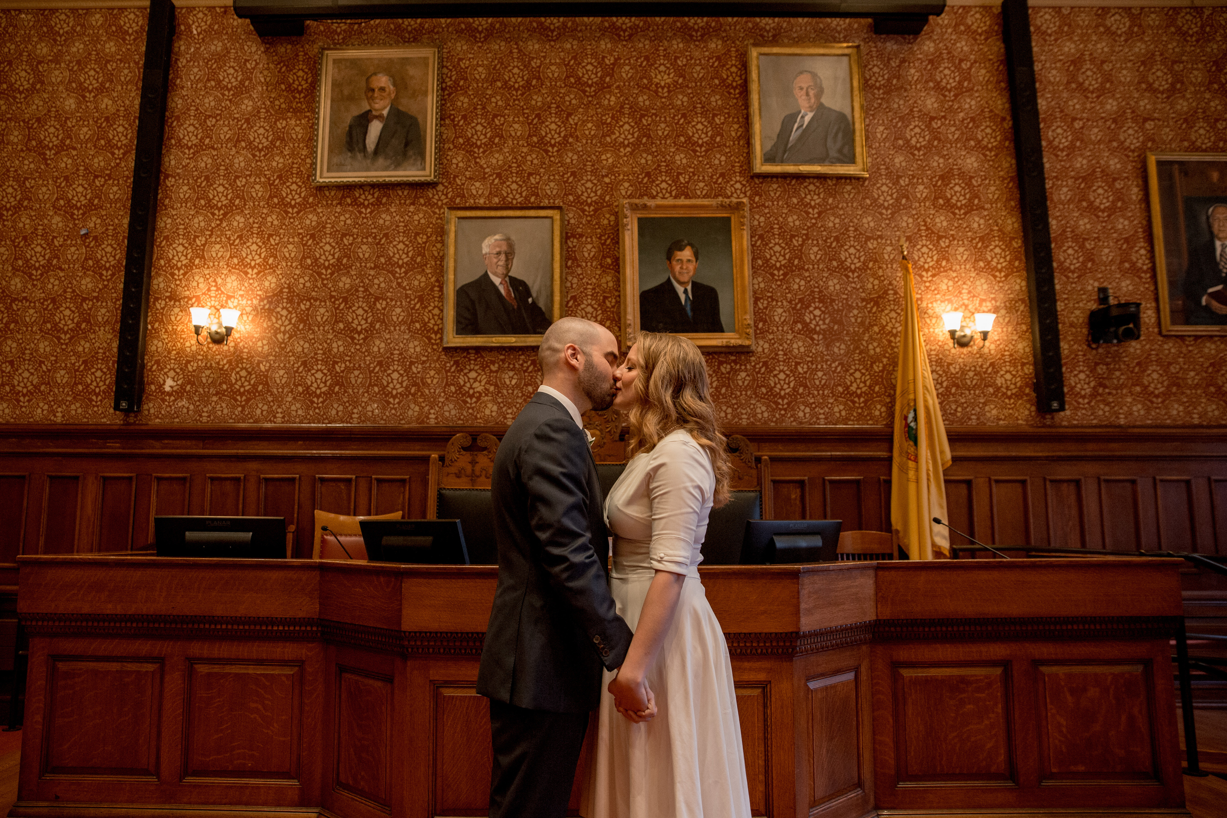 couple kissing inside of cambridge city hall at their elopement