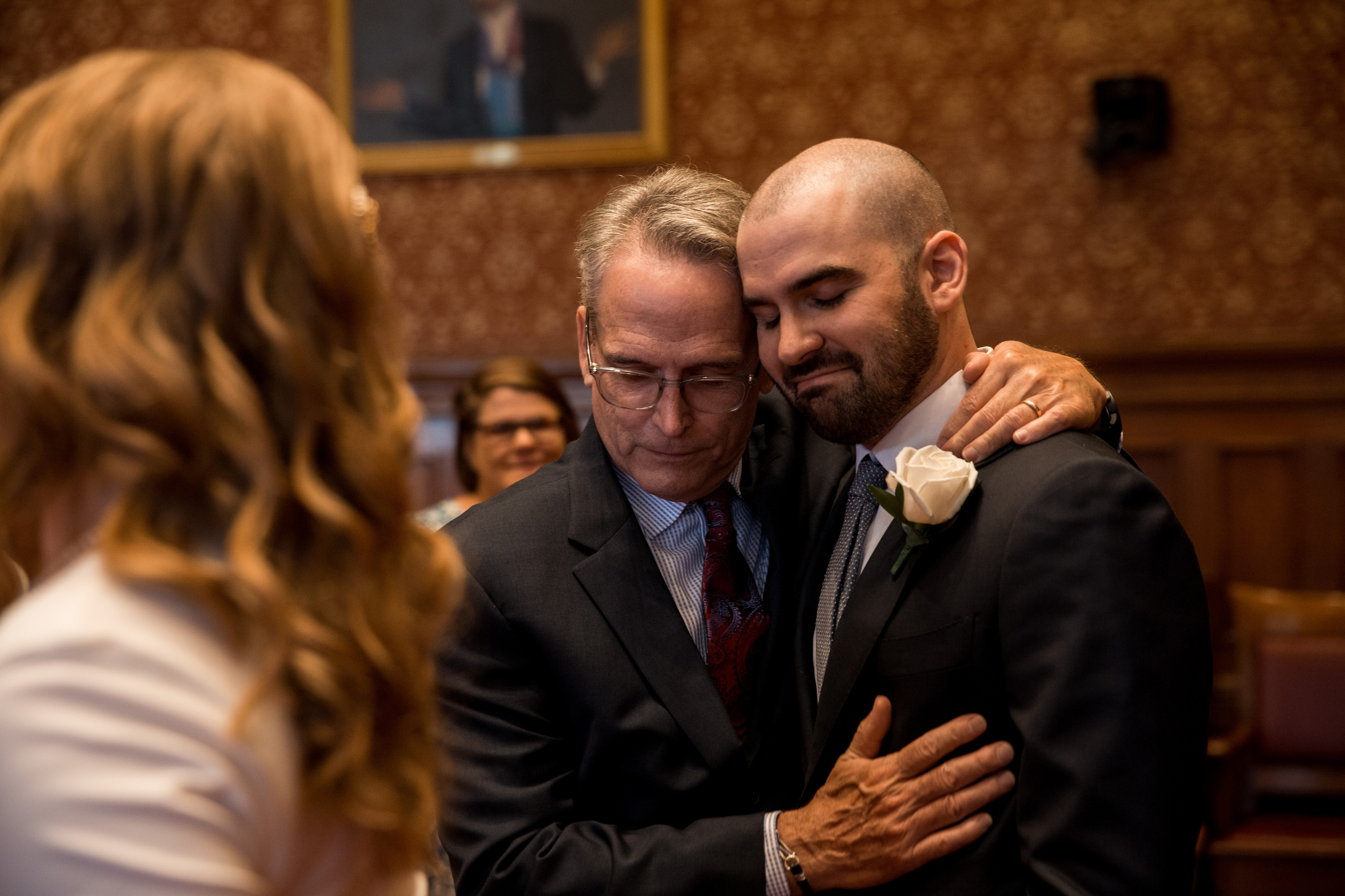 intimate moment with groom and dad at the cambridge city hall