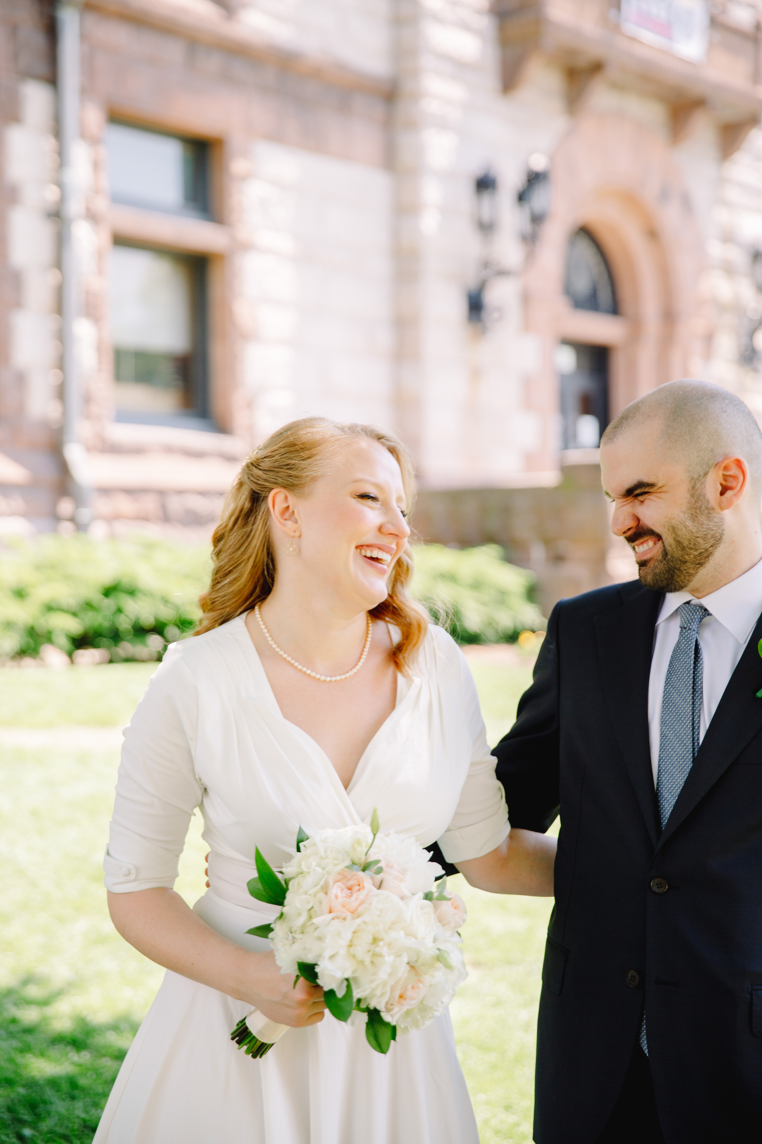 fun lifestyle married couple in front of Cambridge city hall