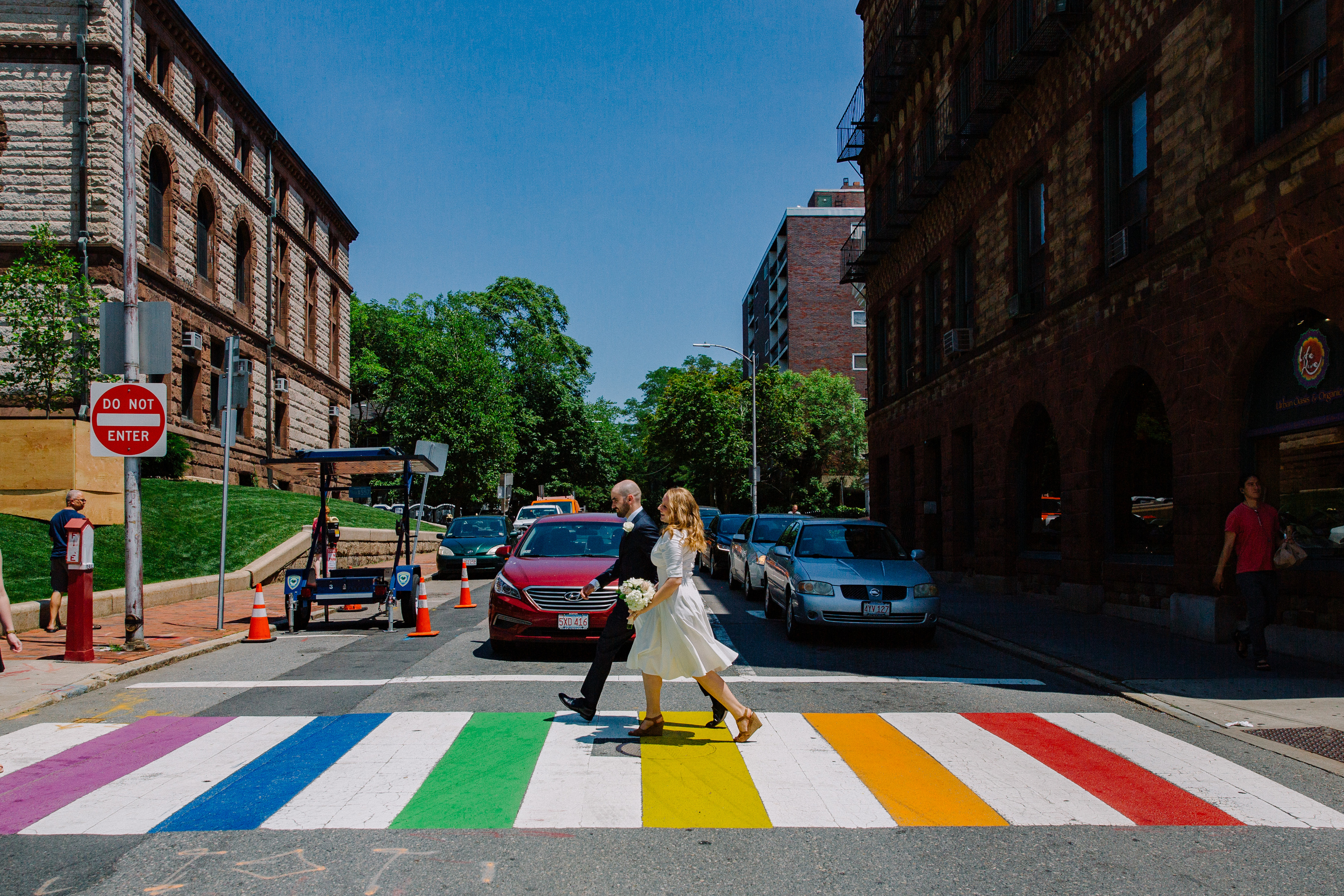 cambridge city hall couple walking in the street after their elopement