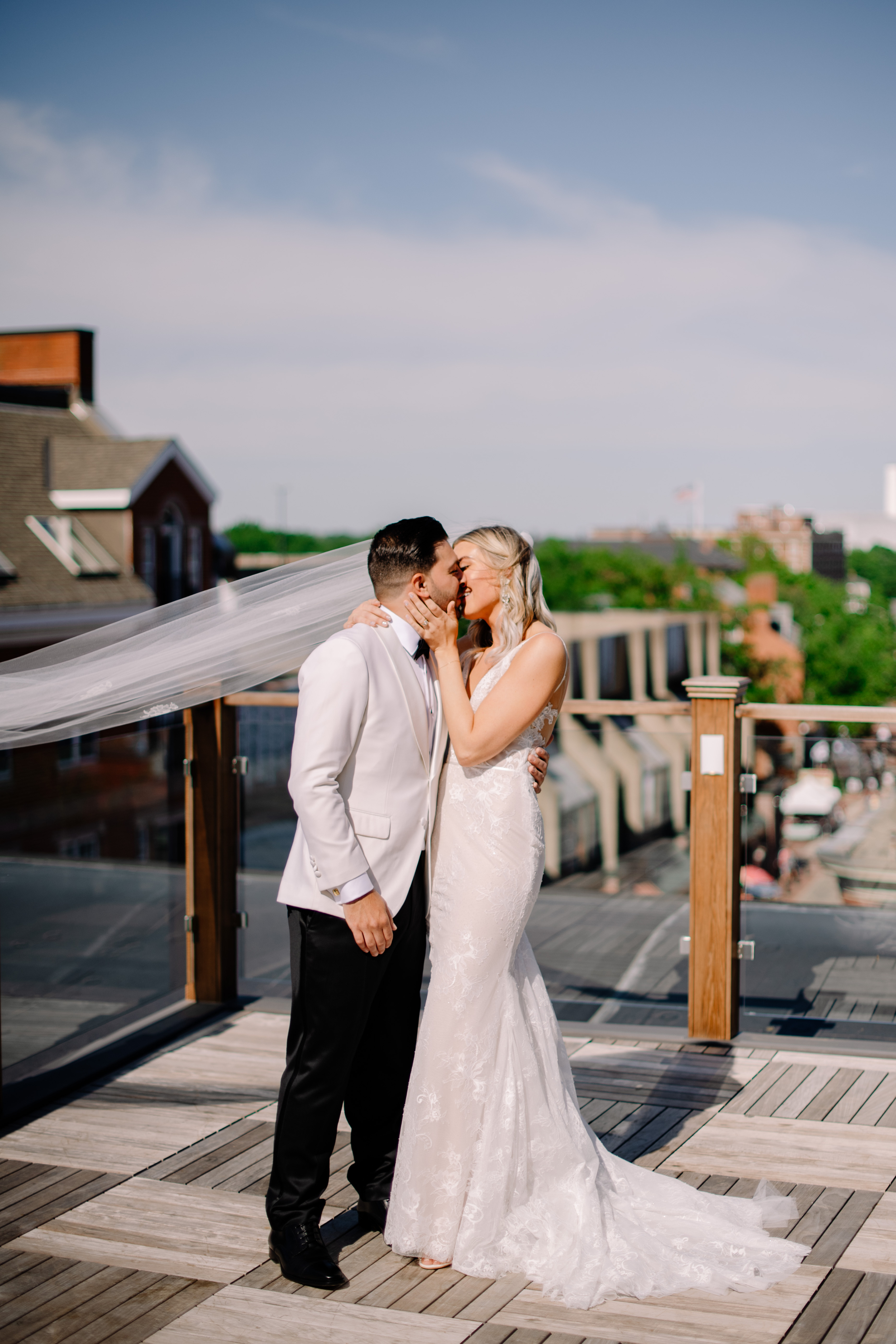 boston area roof top wedding with bride and groom kissing