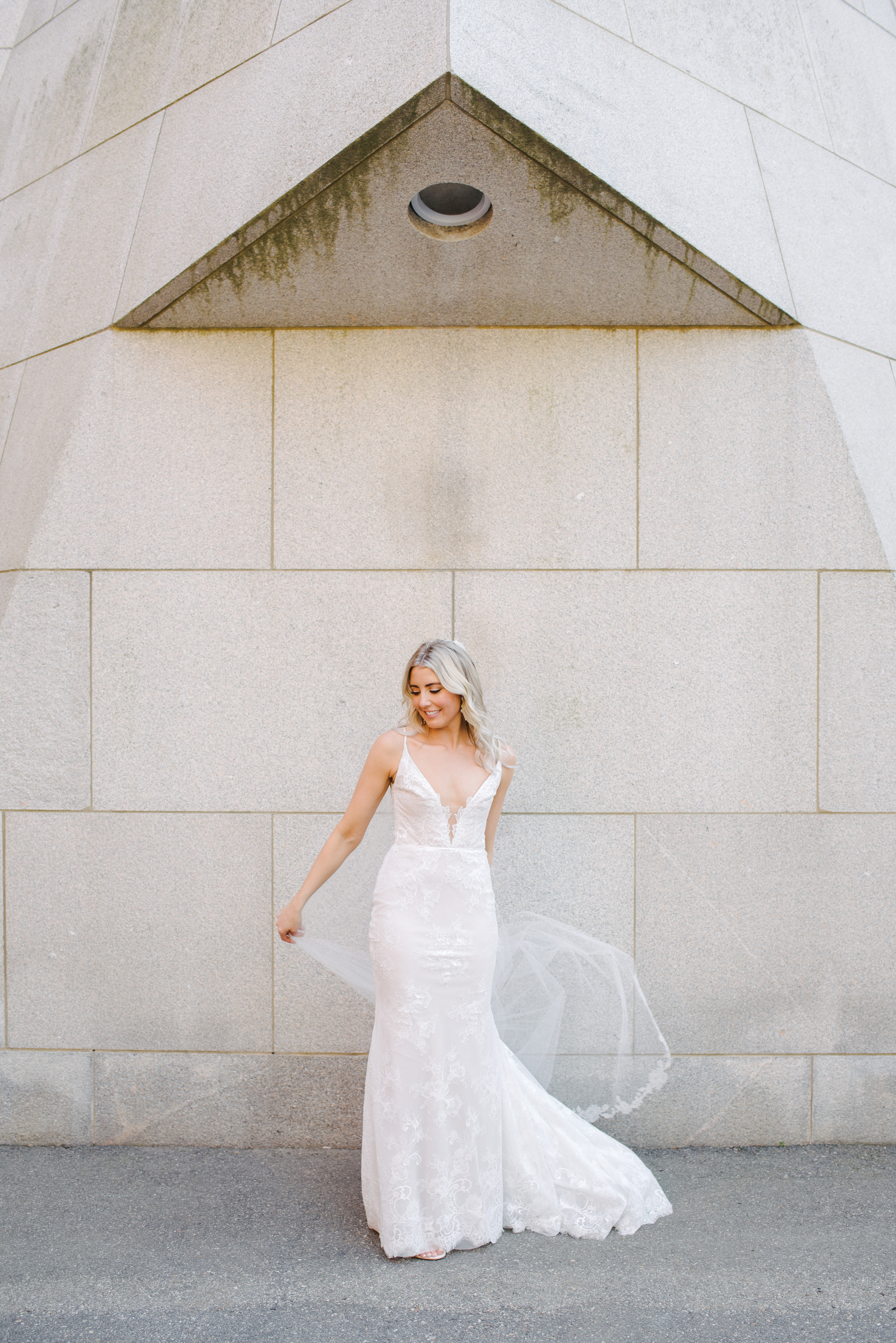 modern and stylish vogue and bride wedding photographer and bride holding veil