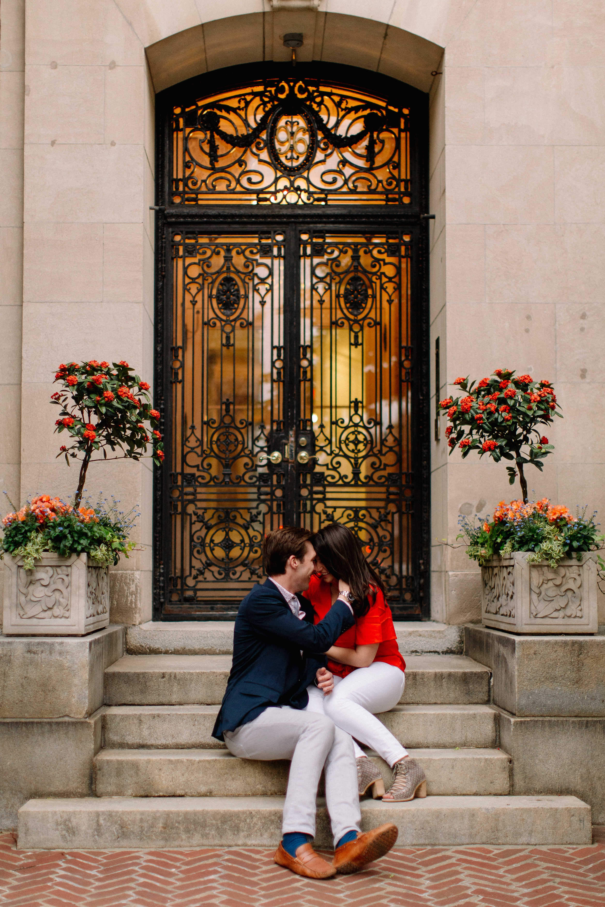 lovely engagement photos of a couple sitting on steps on Marlborough street in back bay