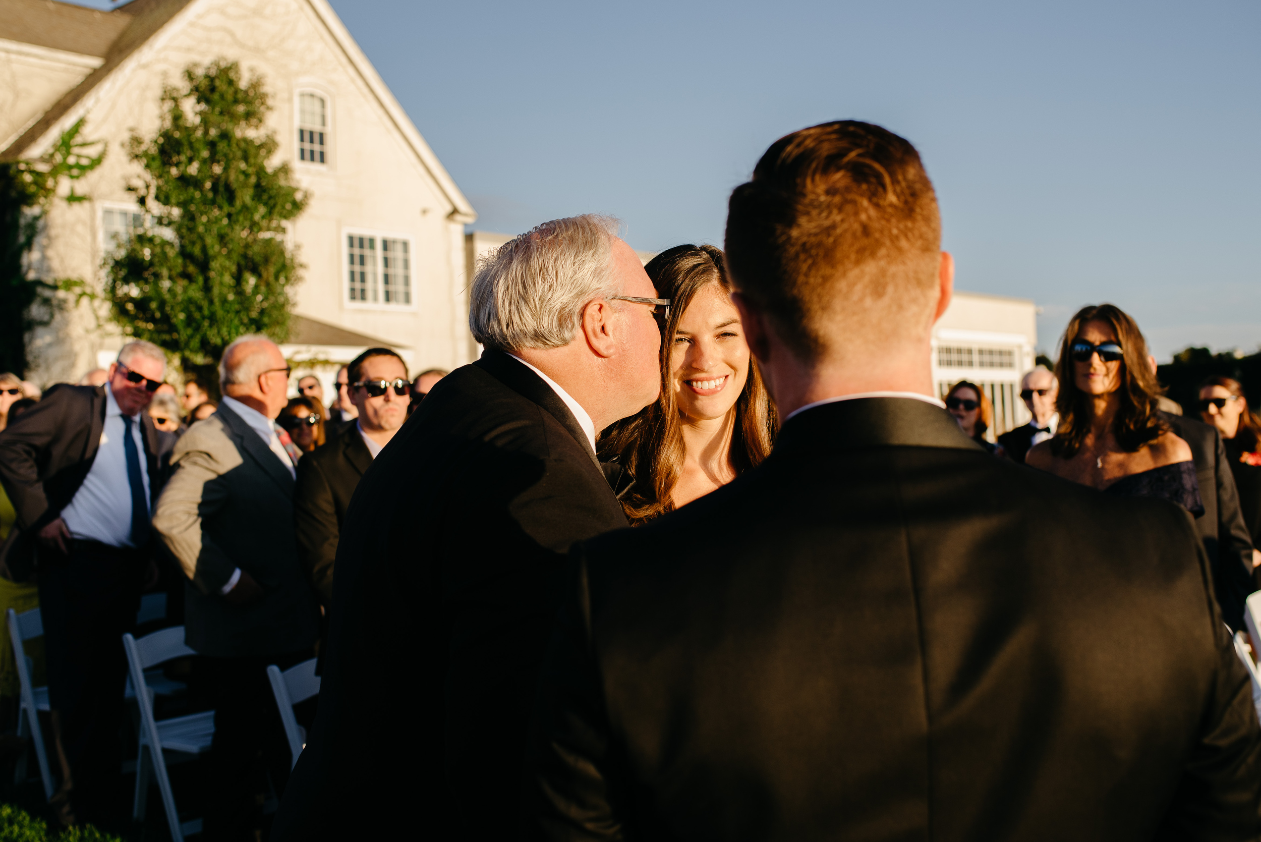 real moments with dad kissing bride down the aisle top new england photojournalistic photos