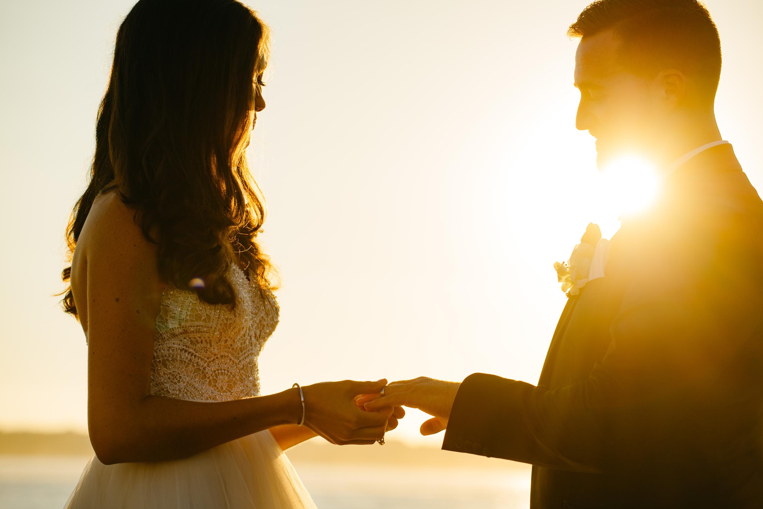 vogue brides ring exchange during sunset island destination wedding wedding ceremony at sunset