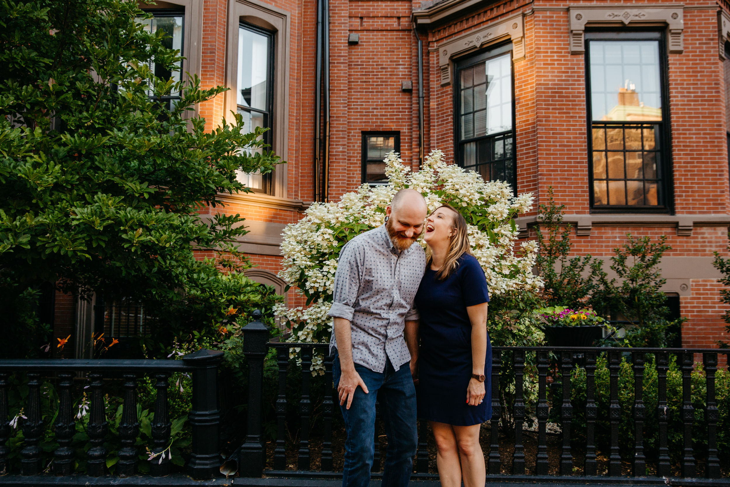 fun engagement inspiration with couple laughing in front of a boston brownstone