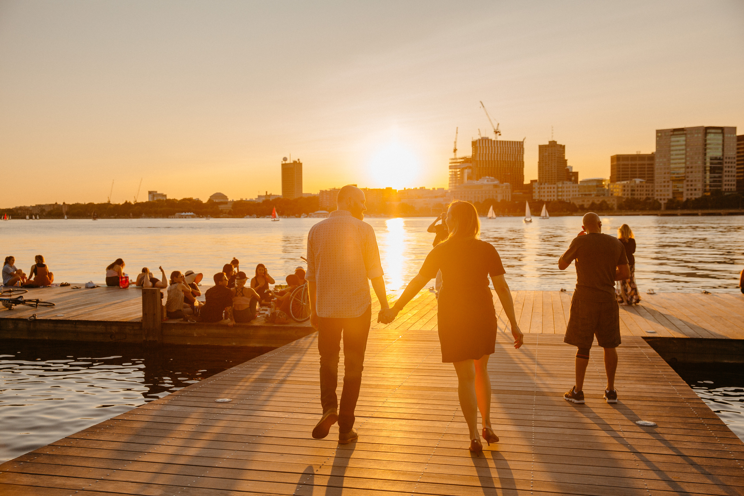 stunning golden sunset on the docks at the charles river esplande in downtown boston