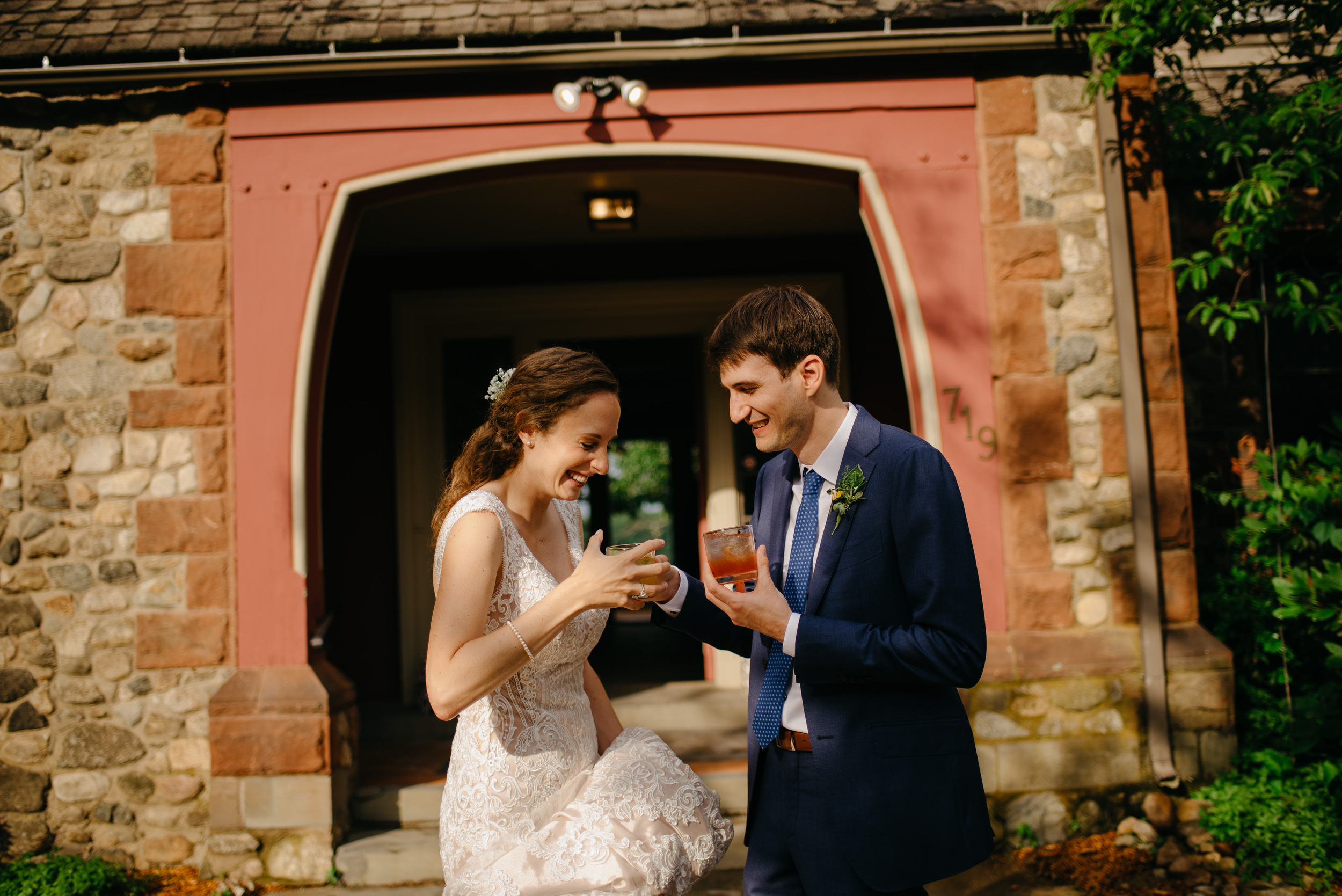 couple laughing with their cocktails at moraine farm