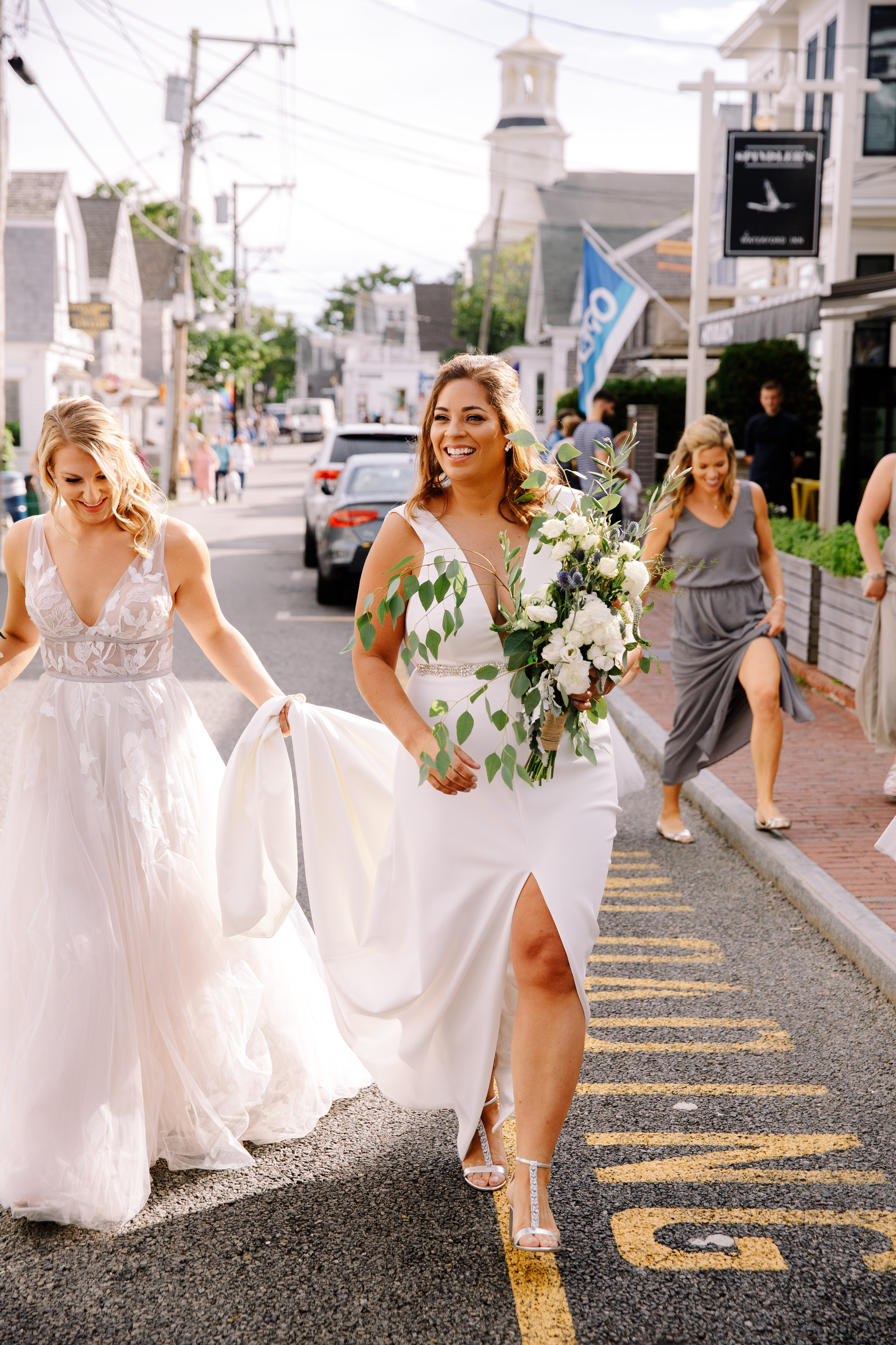 two same-sex brides in wedding dresses walking in downtown providence luxury weddingplanning