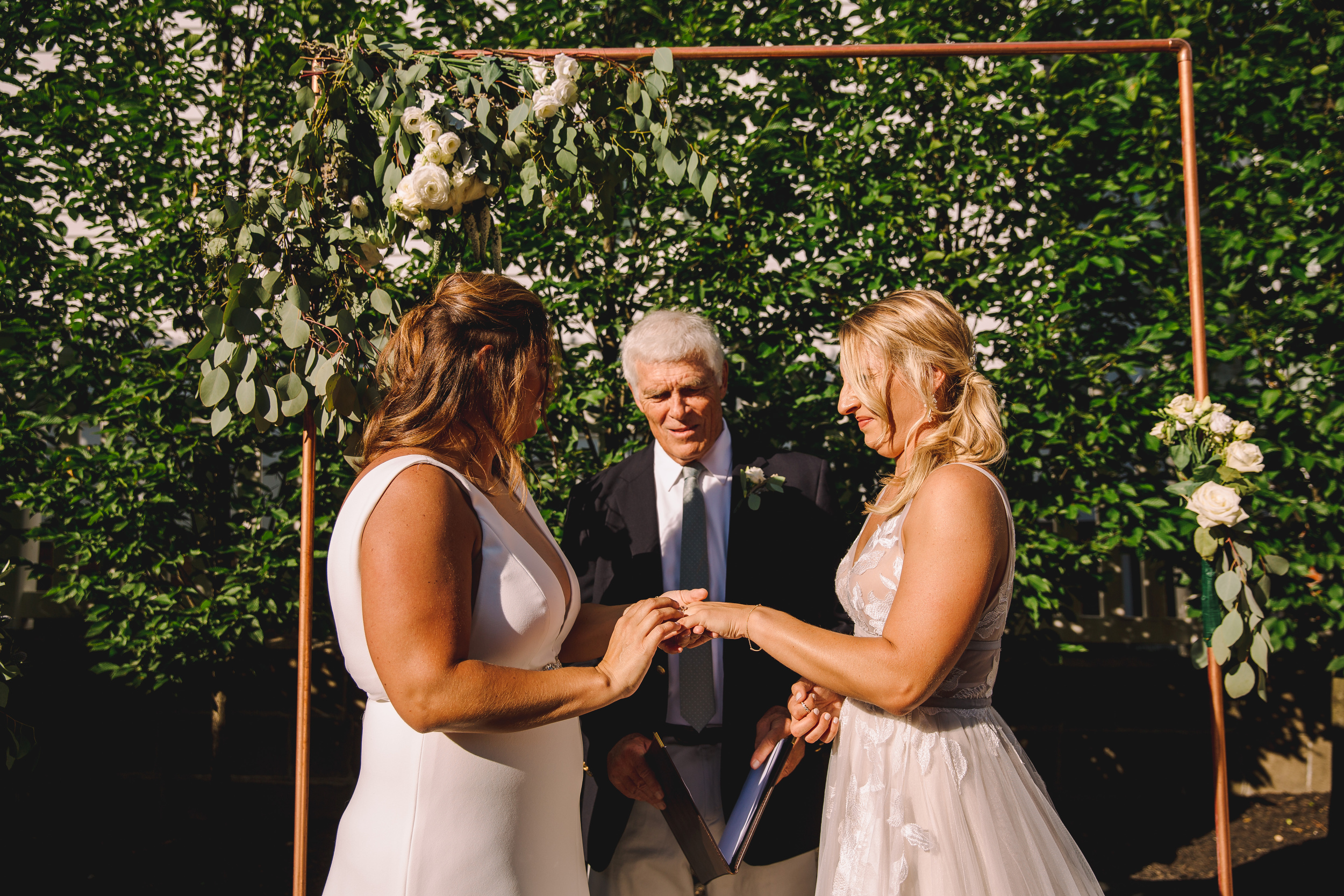 minimal and modern copper wedding cermony arbor at strangers and saints in provincetown