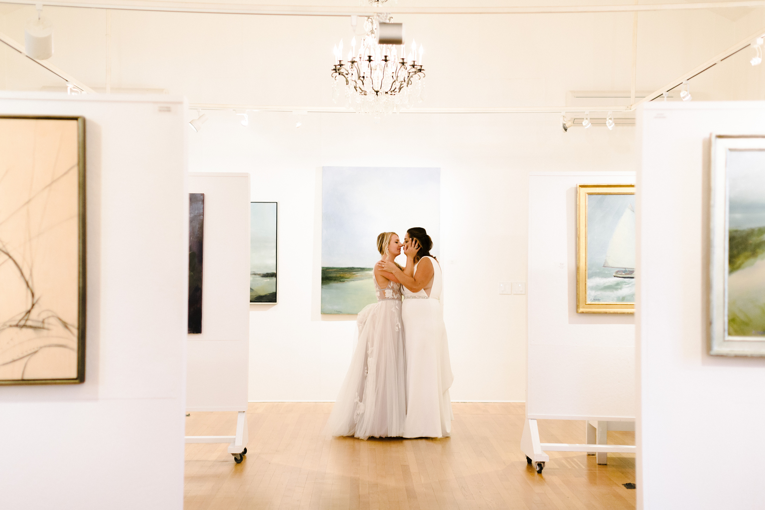 provincetown art gallery wedding ceremony with two beautiful same -sex brides