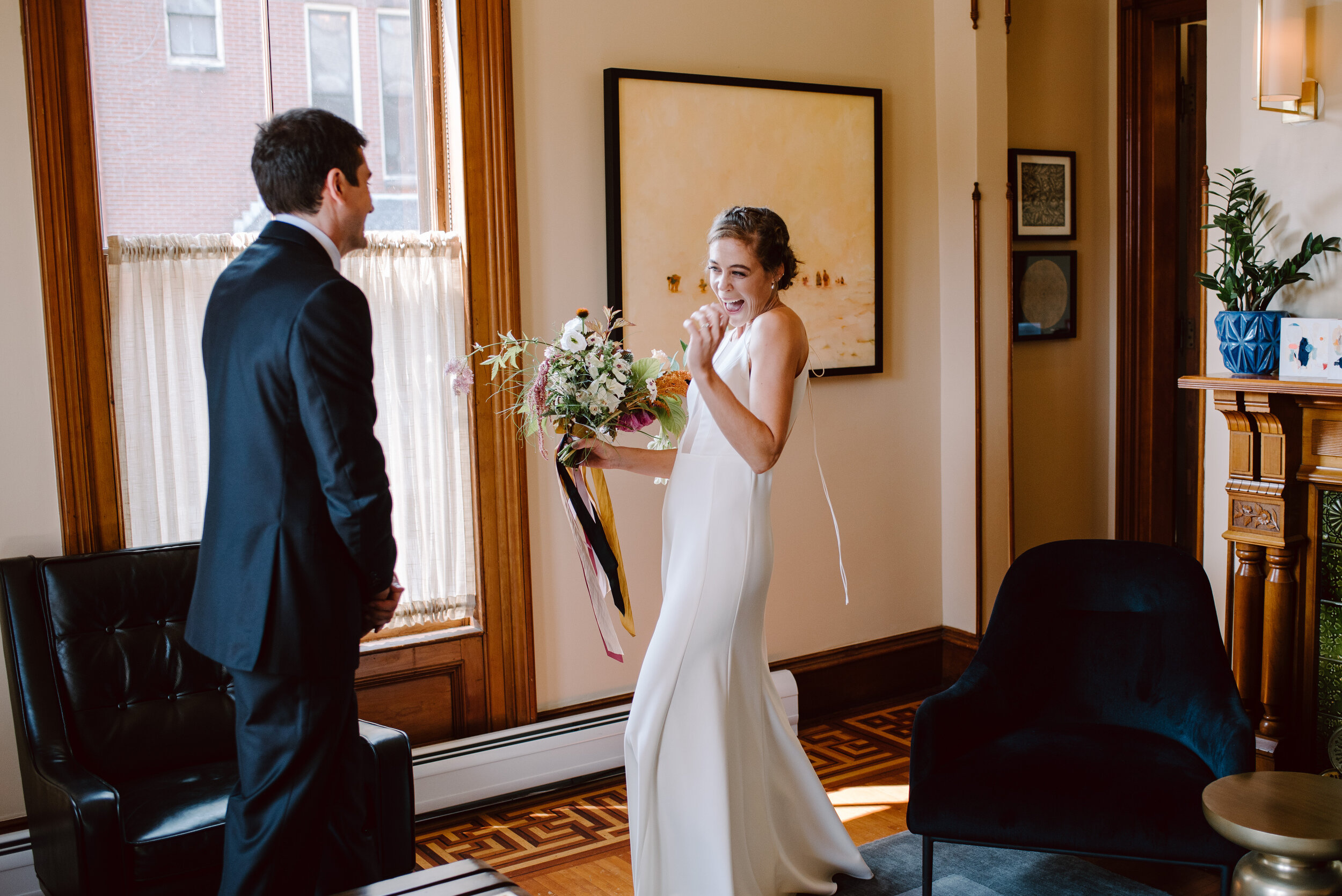 bride and groom first look at the francis hotel in portland maine a modern wedding venue