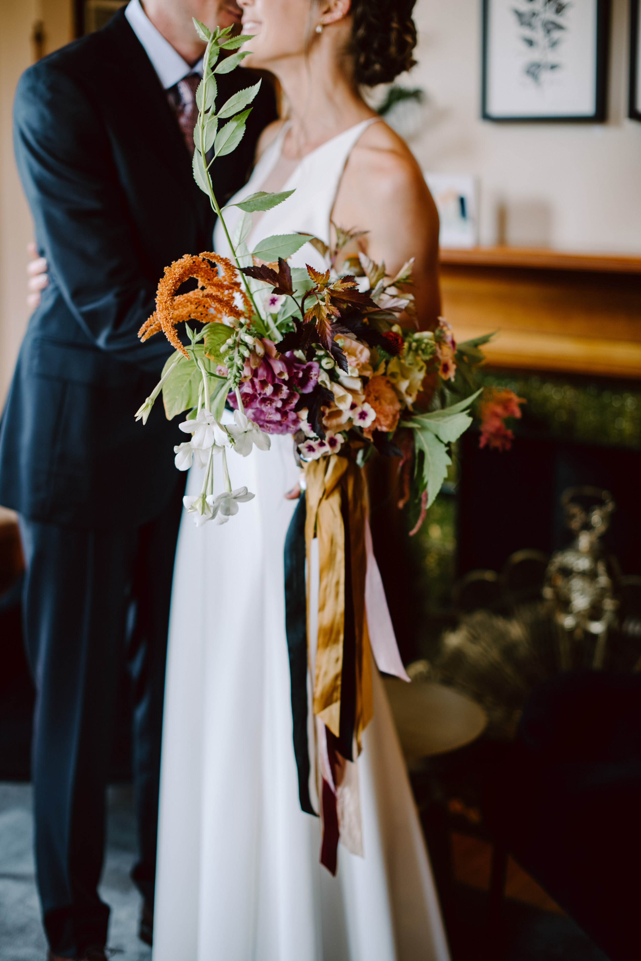 bride and groom portraits at the francis hotel lobby in portland maine