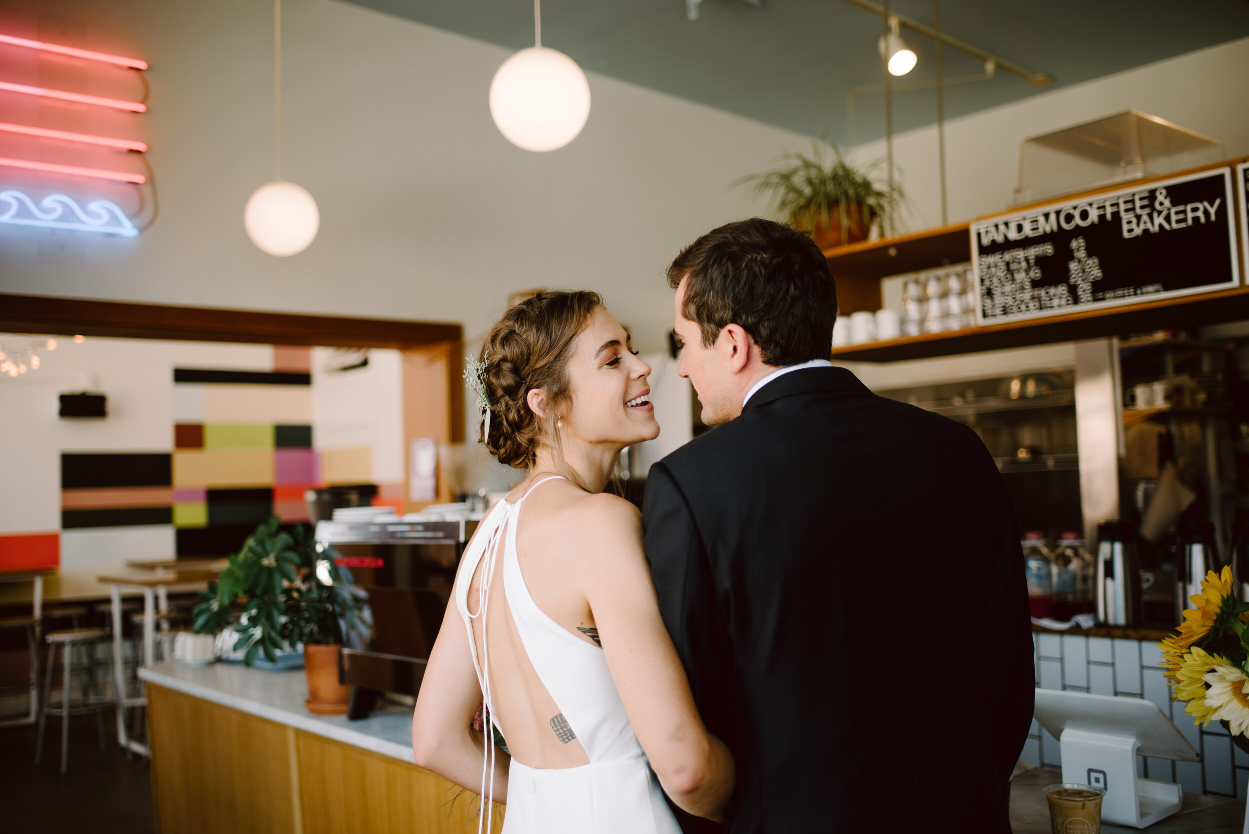 bride and groom ordering coffee at tandem coffee in portland maine 742 congress