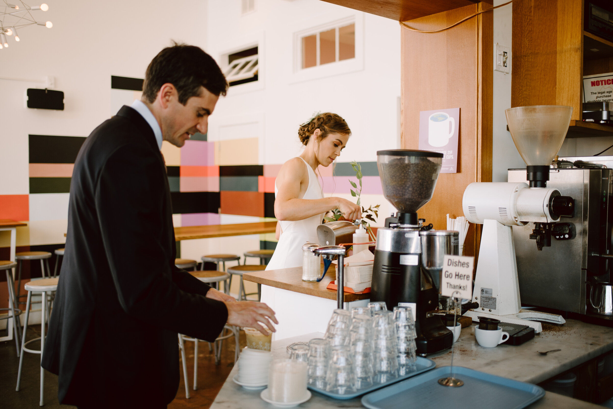 bride and groom drinking tandem coffee at their wedding in portland maine downtown