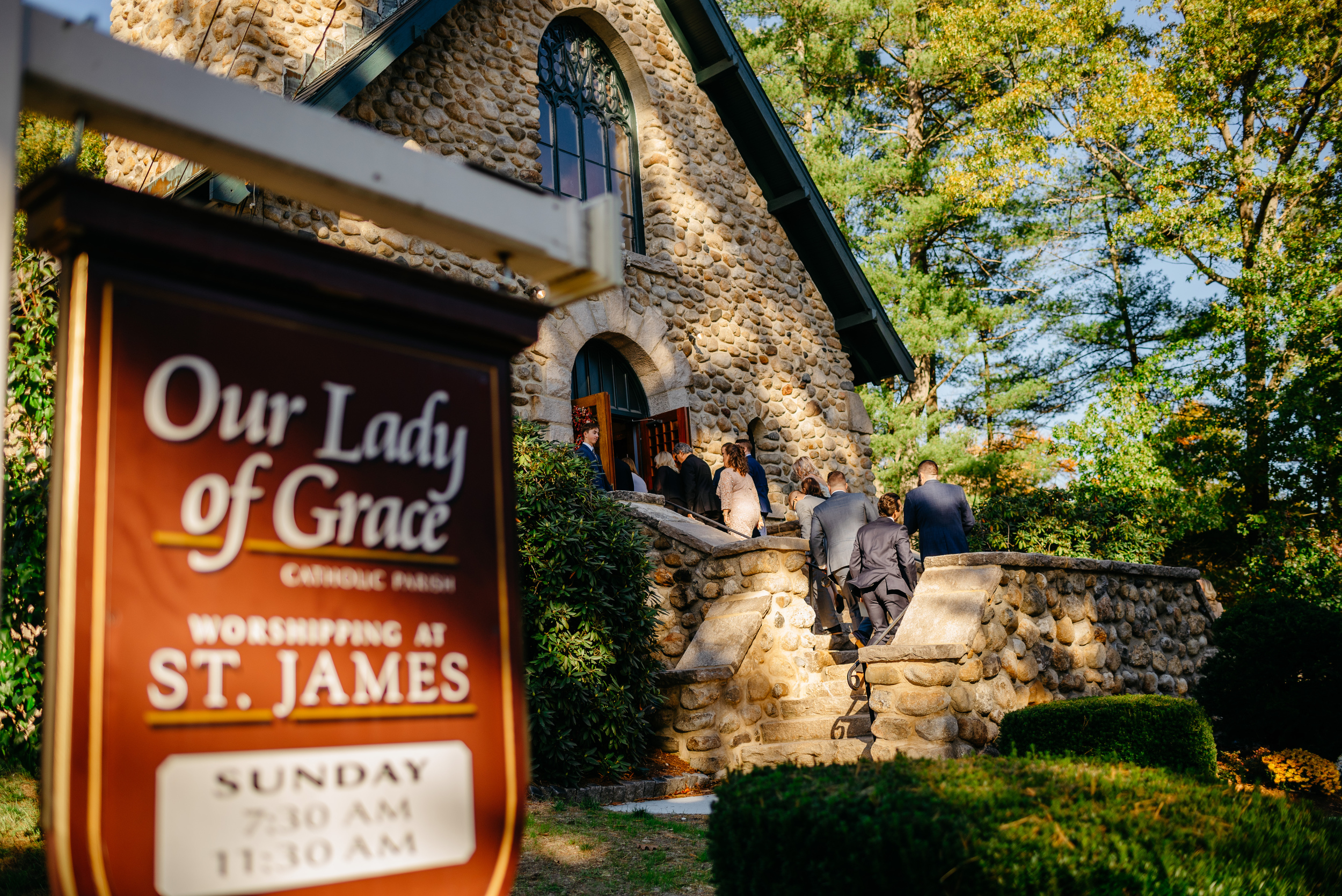 our lady of grace in groton st. james church wedding ceremony sign and guests walking in