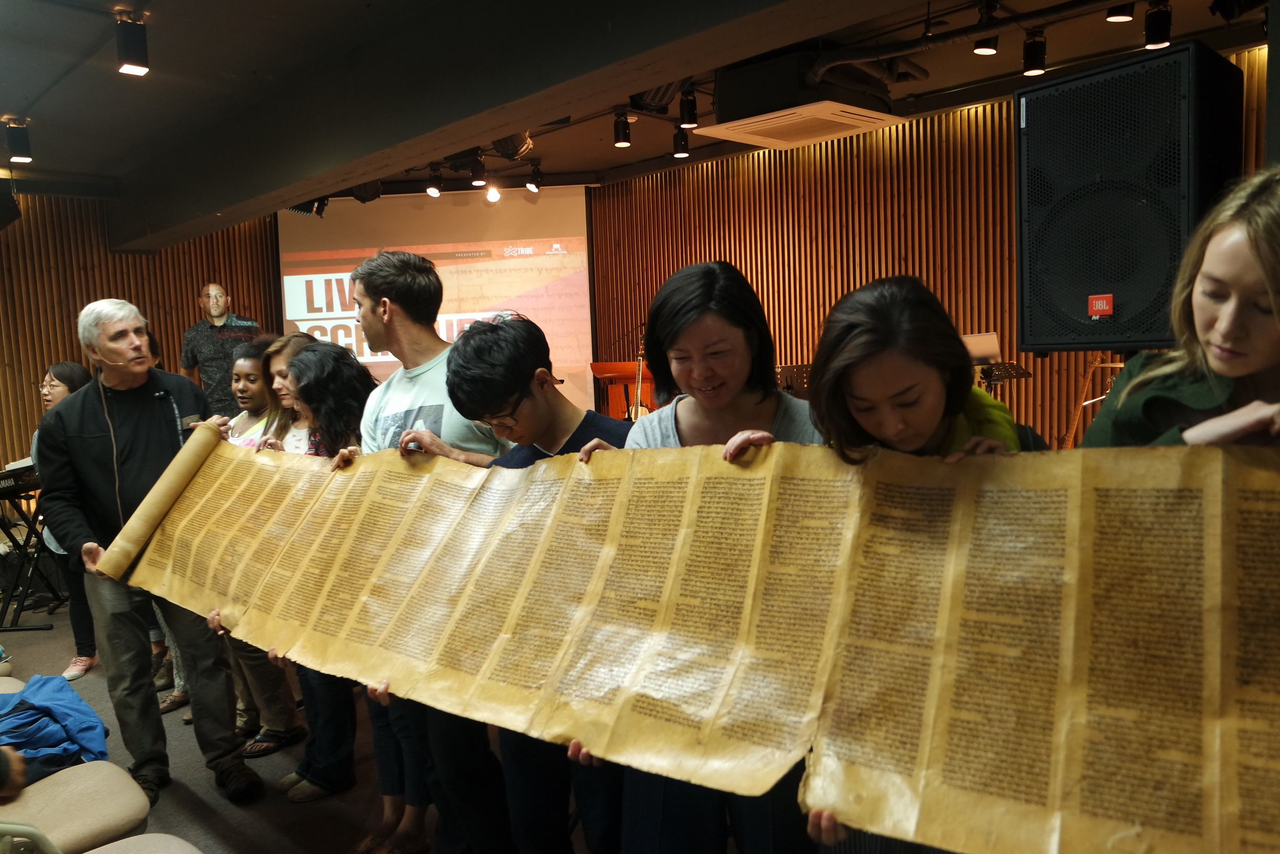 The Torah scroll was slowly and carefully unravelled around the sanctuary