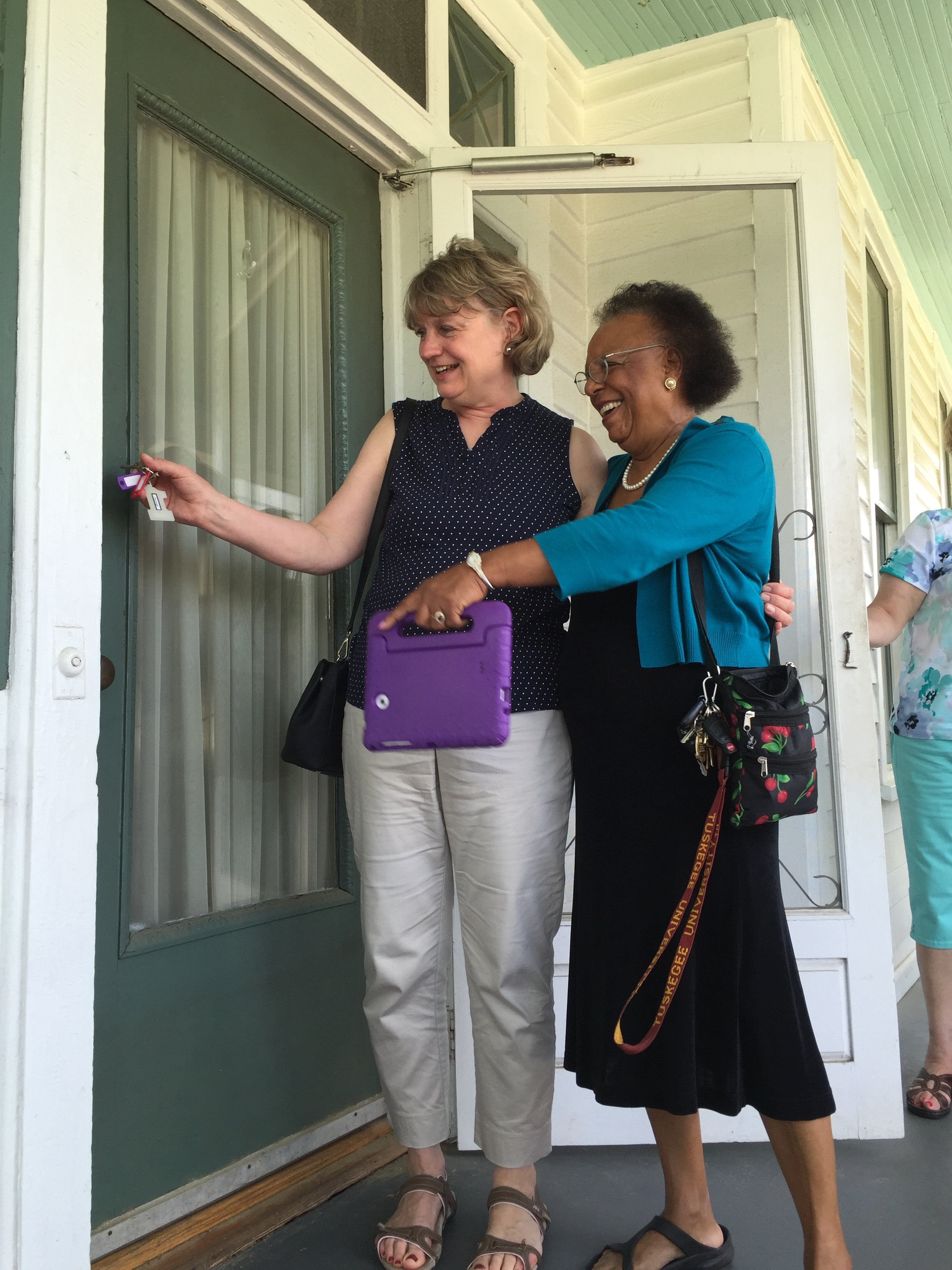 Ann Svennungsen unlocking MLK's parsonage door
