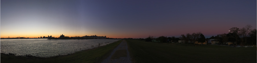 Walks on the levee at dusk.  Or at the park. This is a photo I took on the winter solstice with the sun setting and the full moon rising on the bank of the Mississippi.